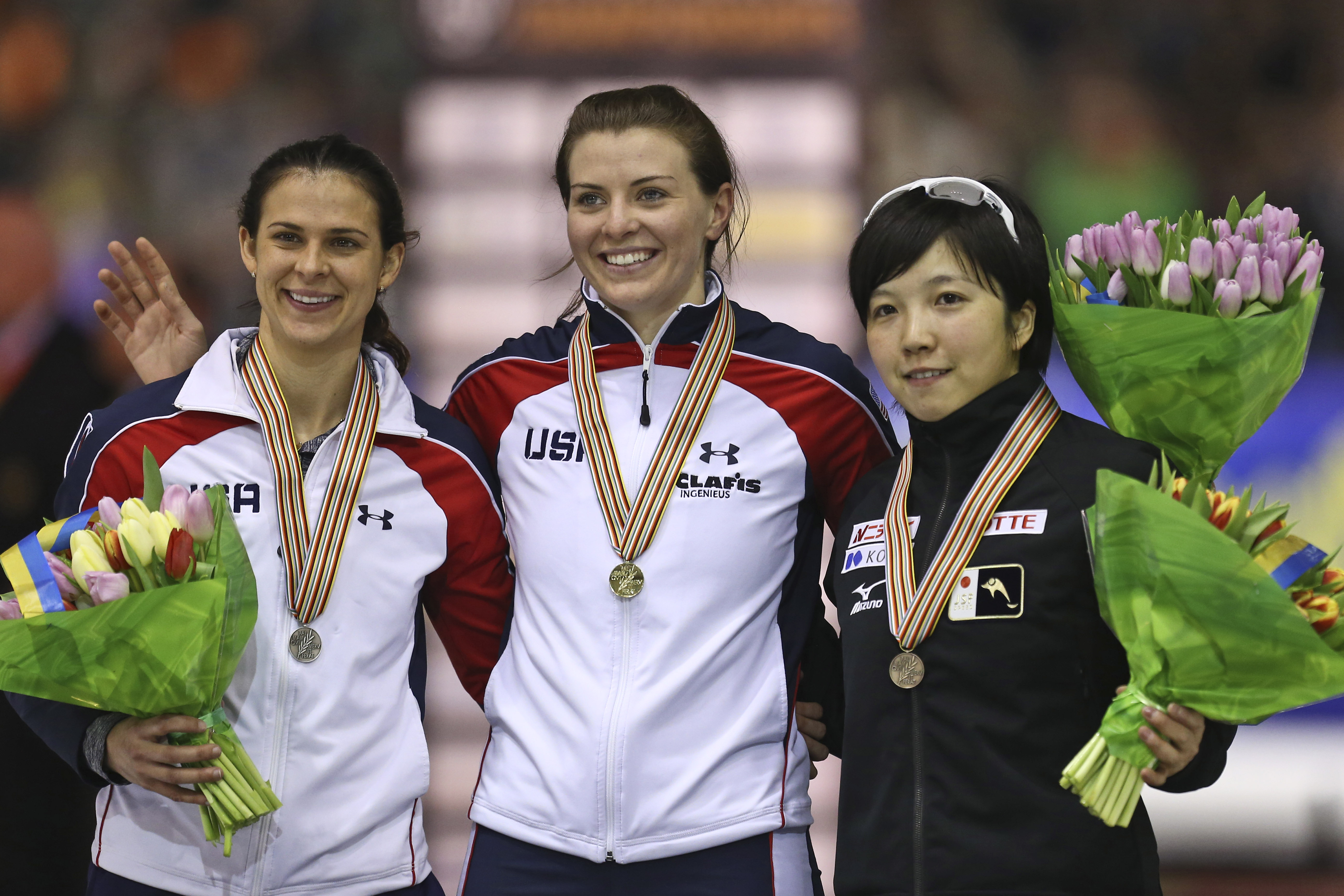 New world champion Heather Richardson of the U.S., center and gold medal, Brittany Bowe of the U.S., left and silver medal, and Nao Kodaira of Japan, right and bronze medal, pose on the podium of the women's 500 meter race of the speedskating single distance world championships at Thialf ice rink in Heerenveen, Netherlands, Saturday, Feb. 14, 2015. (AP Photo/Peter Dejong)