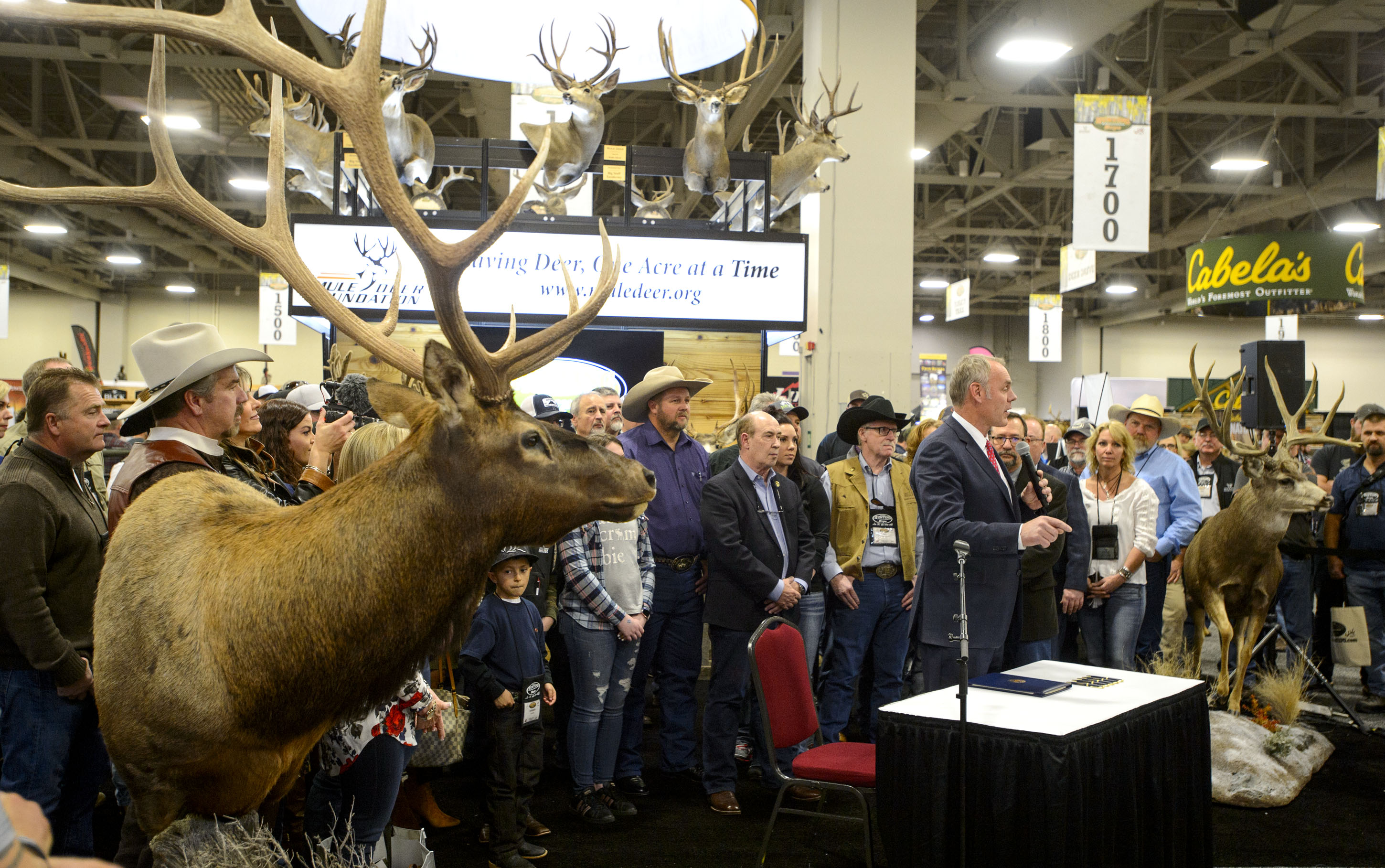 (Steve Griffin  |  The Salt Lake Tribune)  U.S. Secretary of the Interior Ryan Zinke stands with people attending the Western Hunting and Conservation Expo at the Salt Palace Convention Center as he prepares to sign Secretarial Order 3362, which will improve habitat quality and western big game winter range and migration corridors for big game, in Salt Lake City Friday February 9, 2018.