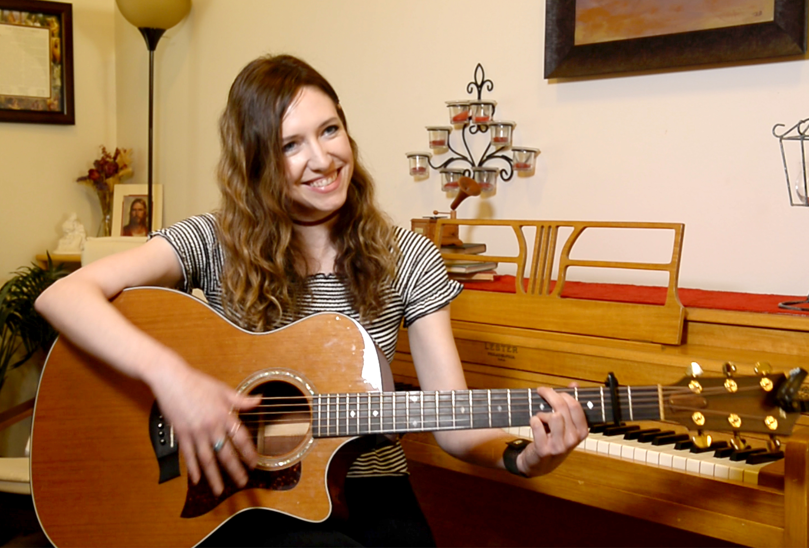 "(Rick Egan  |  The Salt Lake Tribune) April Meservy plays the guitar at her home in Provo on Wednesday, Febr. 7, 2018. Meservy recorded a cover of U2's ""With or Without You,""  which will be used by Canadian pairs figure skaters Eric Radford and Meagan Duhamel  as they perform at this year's Winter Olympic Games in PyeongChang, South Korea."
