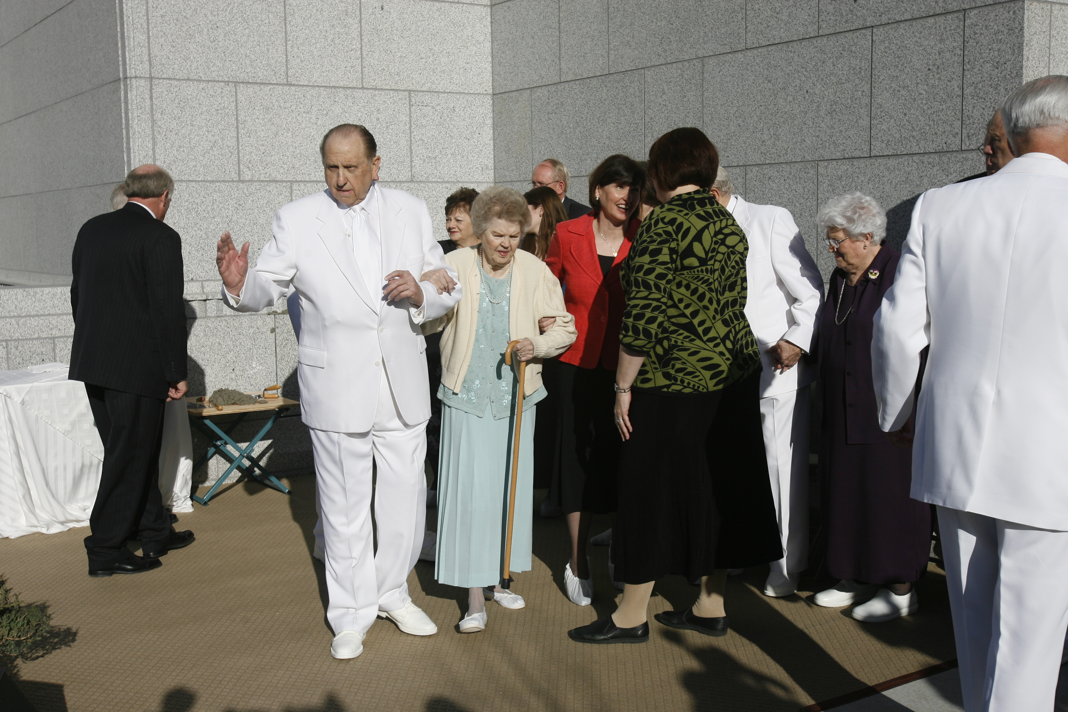 (Rick Egan  |  The Salt Lake Tribune) President Thomas S. Monson, and his wife, Frances, walk away from the cornerstone after it was laid in a ceremony at the new Draper Temple in July 2007.
