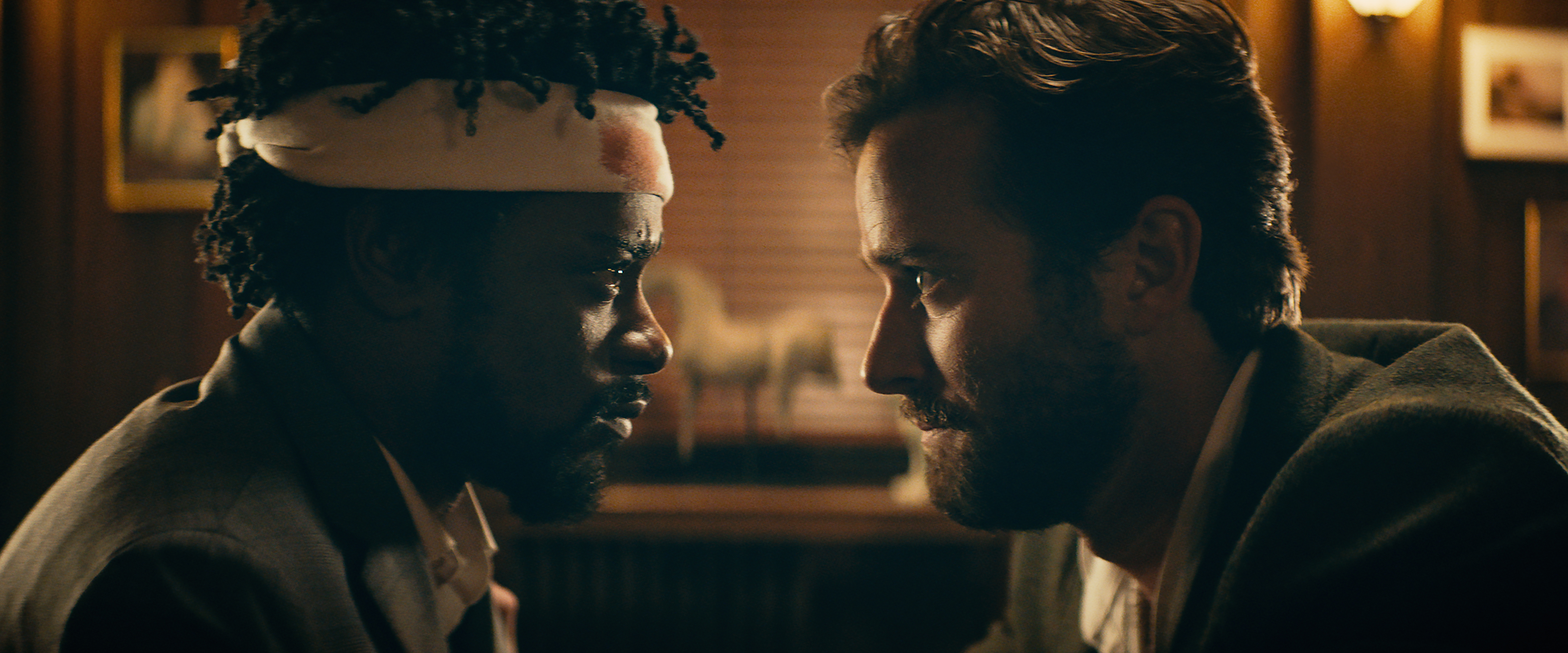 """(Annapurna Pictures via Associated Press) Lakeith Stanfield, left, and Armie Hammer in a scene from """"Sorry to Bother You."""""""