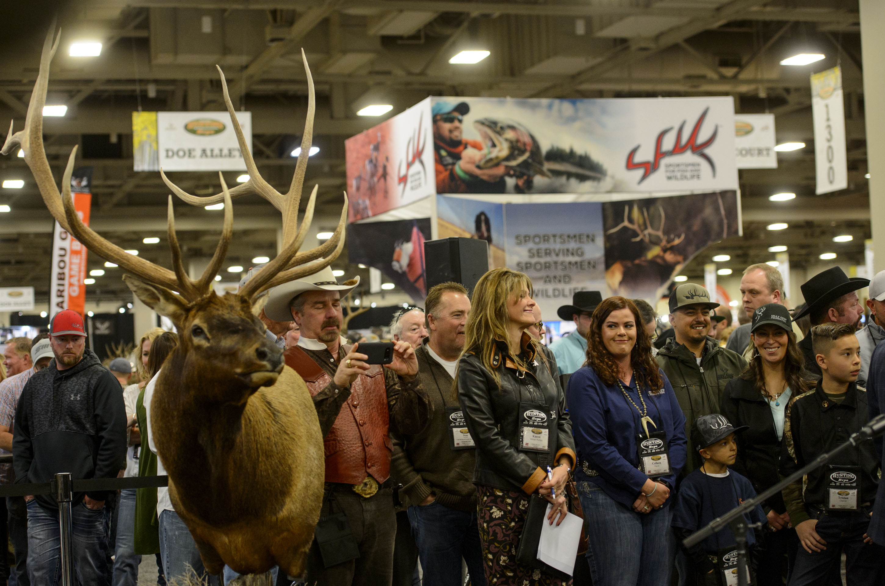 (Steve Griffin  |  The Salt Lake Tribune)  A crowd at the Western Hunting and Conservation Expo at the Salt Palace Convention Center in Salt Lake City on Friday, Feb. 9, 2018 wait for U.S. Secretary of the Interior Ryan Zinke to arrive.