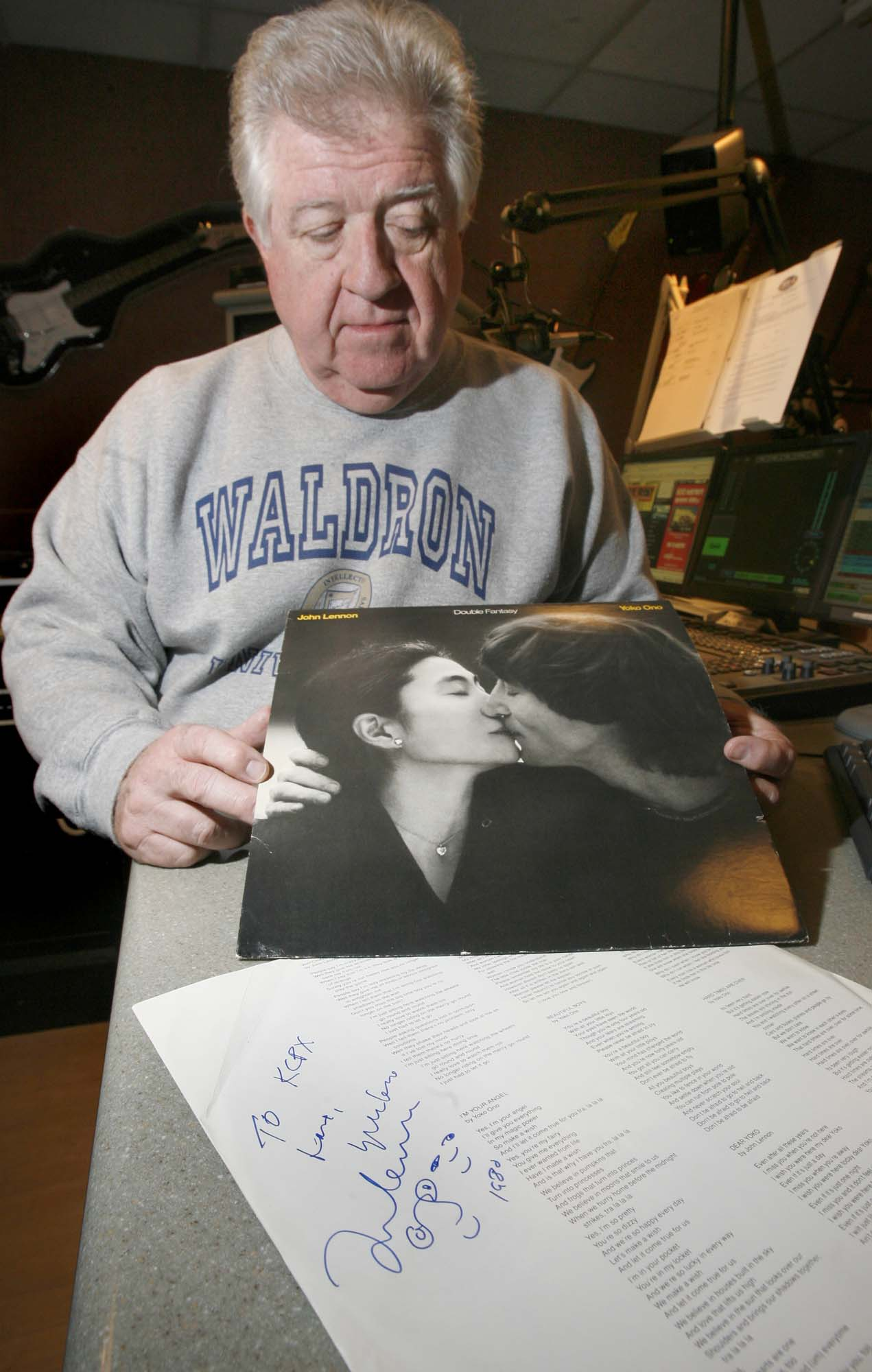 "(Paul Fraughton  |  The Salt Lake Tribune) In this 2009 file photo, Gary ""Wooly"" Waldron, a longtime Salt Lake DJ, holds his copy of John Lennon's ""Double Fantasy"" signed by Lennon just hours before he was murdered."
