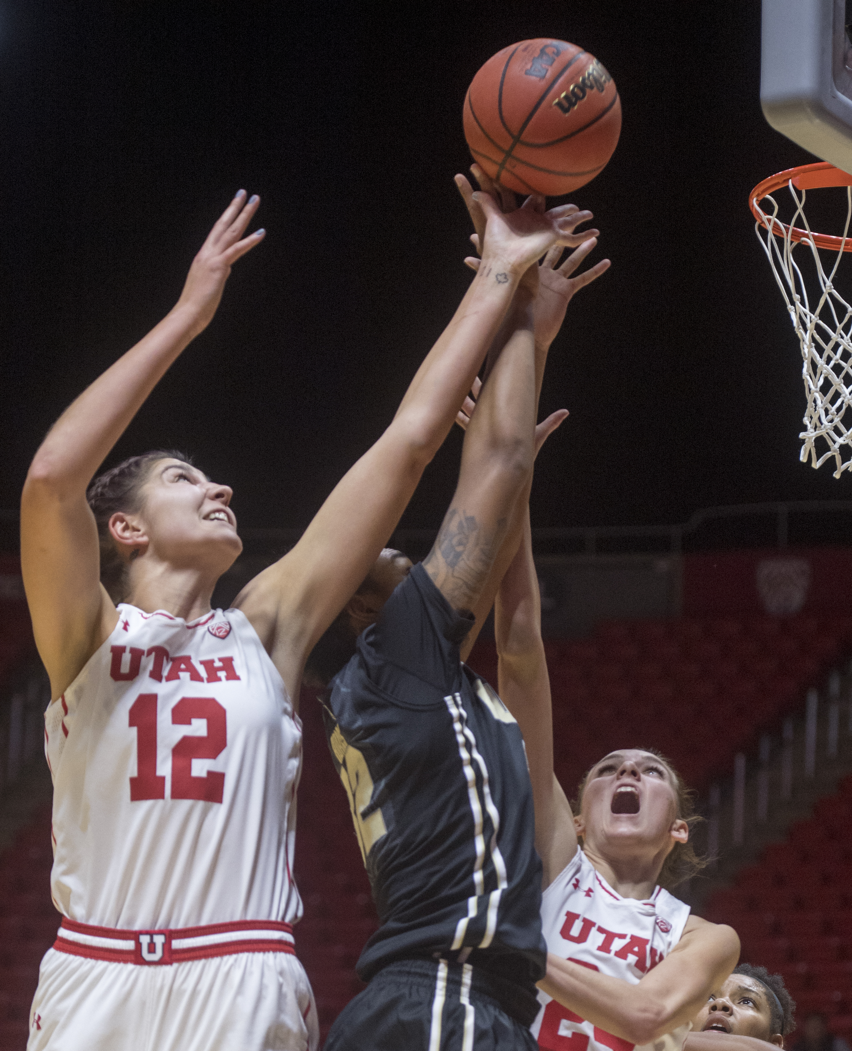 (Rick Egan  |  The Salt Lake Tribune)  Utah Utes forward Emily Potter (12) goes up for a rebound along with Purdue Boilermakers forward Ae'Rianna Harris (32), in basketball action Utah Utes vs. Purdue Boilermakers, at the Thomas M. Huntsman Center, Monday, November 20, 2017.