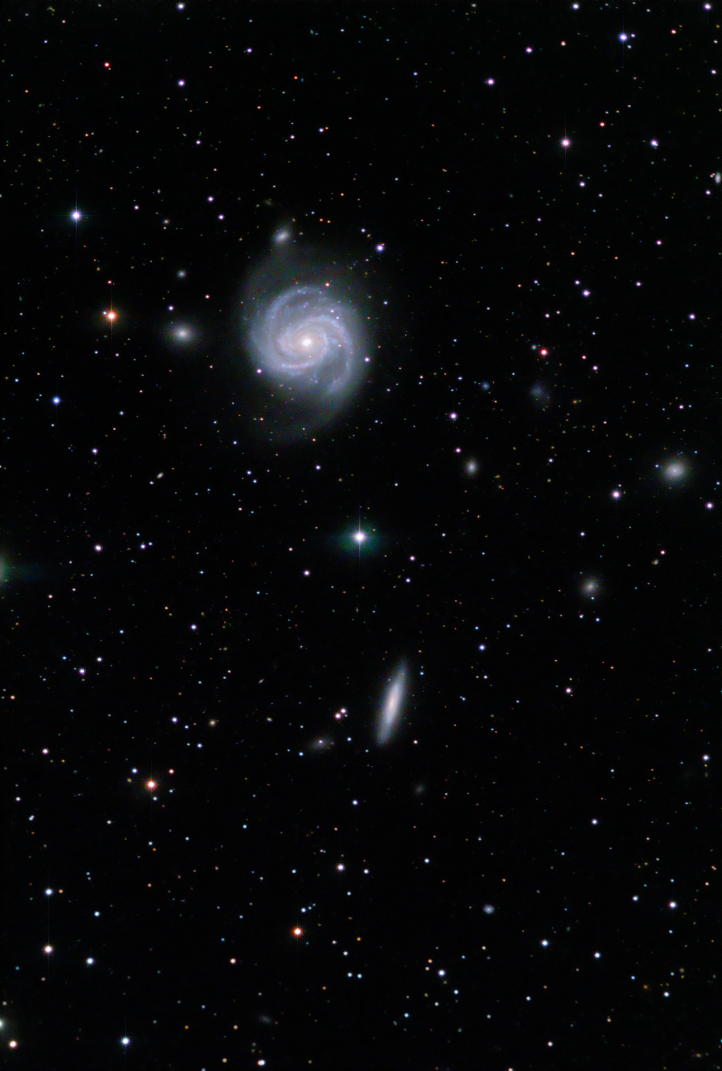 (Photo courtesy of Mark Bailey) Galaxies M100, also known as the Blow Dryer Galaxy, and NGC 4312. These galaxies are members of the Virgo cluster of galaxies, 50 million light years away, in constellation Coma Berenices. There are several other dwarf galaxies also in the image, photographed at Torrey House Alpenglow Observatory, May 28, 2017.