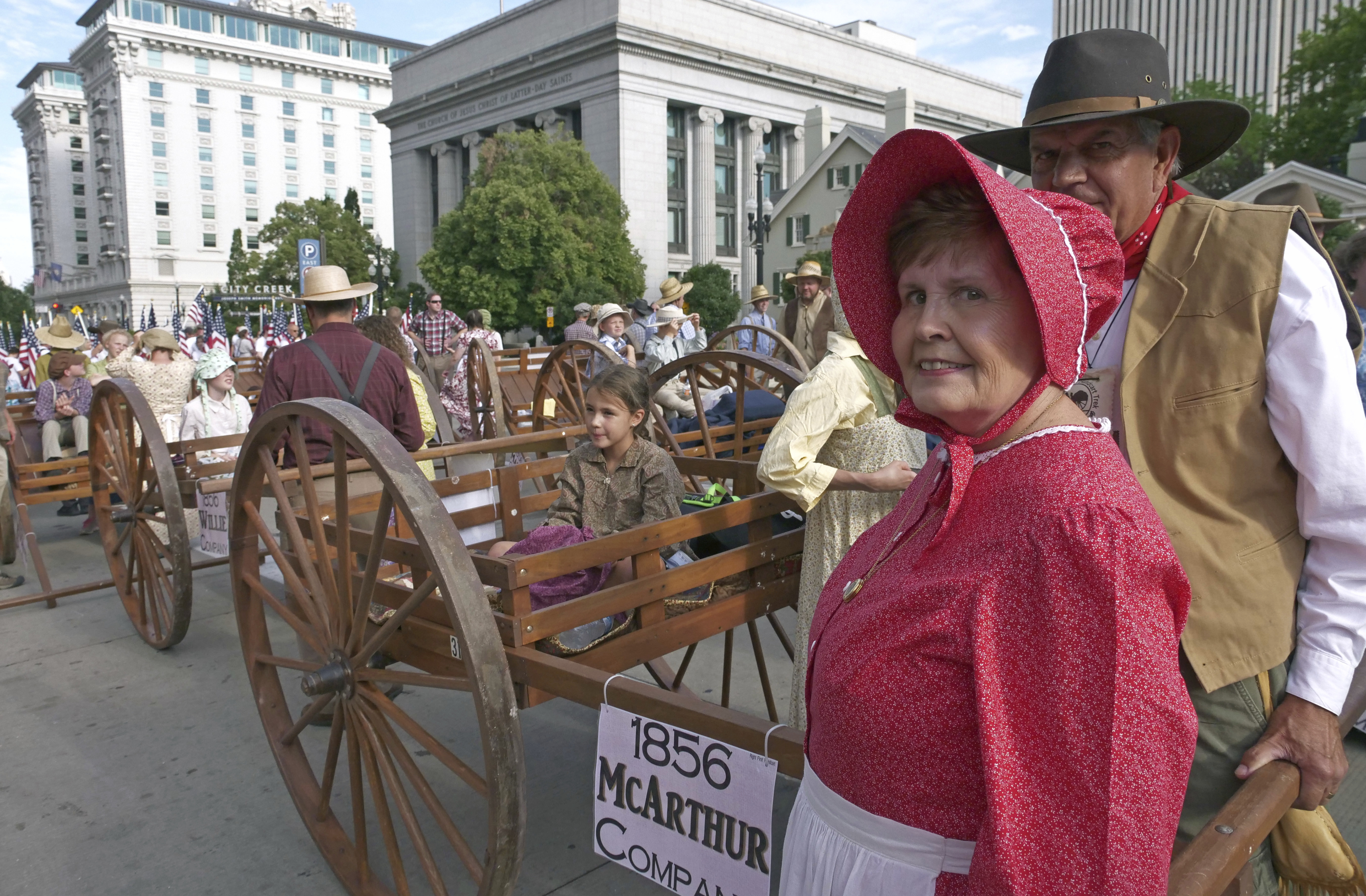 People celebrate the state's Mormon heritage during the Pioneer Day parade Tuesday, July 24, 2018, in Salt Lake City, as people in Utah gather to celebrate the state's history and recognize Mormon pioneers who trekked West in search of religious freedom. Pioneer Day is a beloved only-in-Utah holiday every July 24 that features parades, rodeos, fireworks and more. (AP Photo/Rick Bowmer)