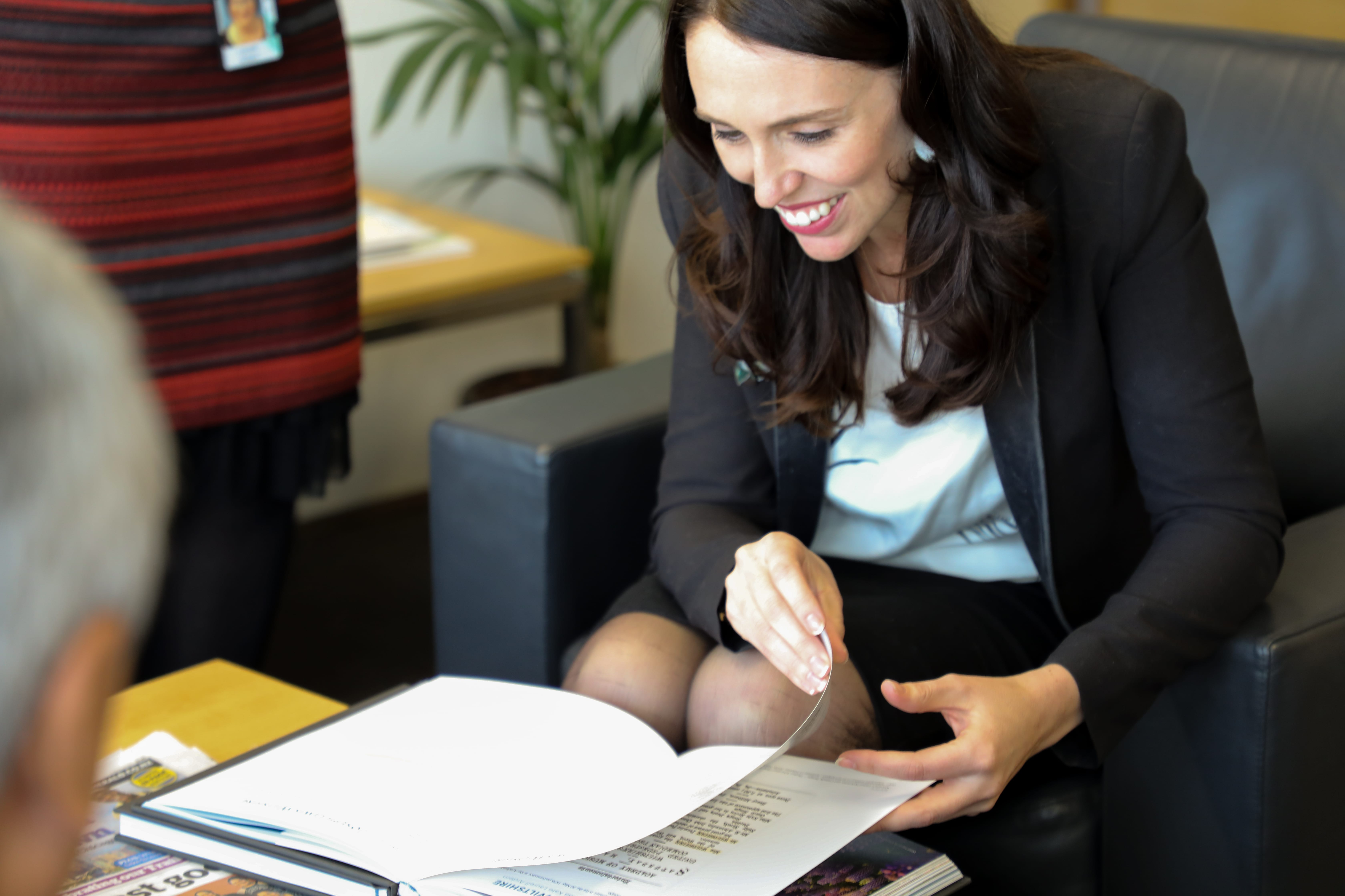 (Photo courtesy of The Church of Jesus Christ of Latter-day Saints) Jacinda Ardern, prime minister of New Zealand, reads from a volume of her family history Sept. 18, 2018