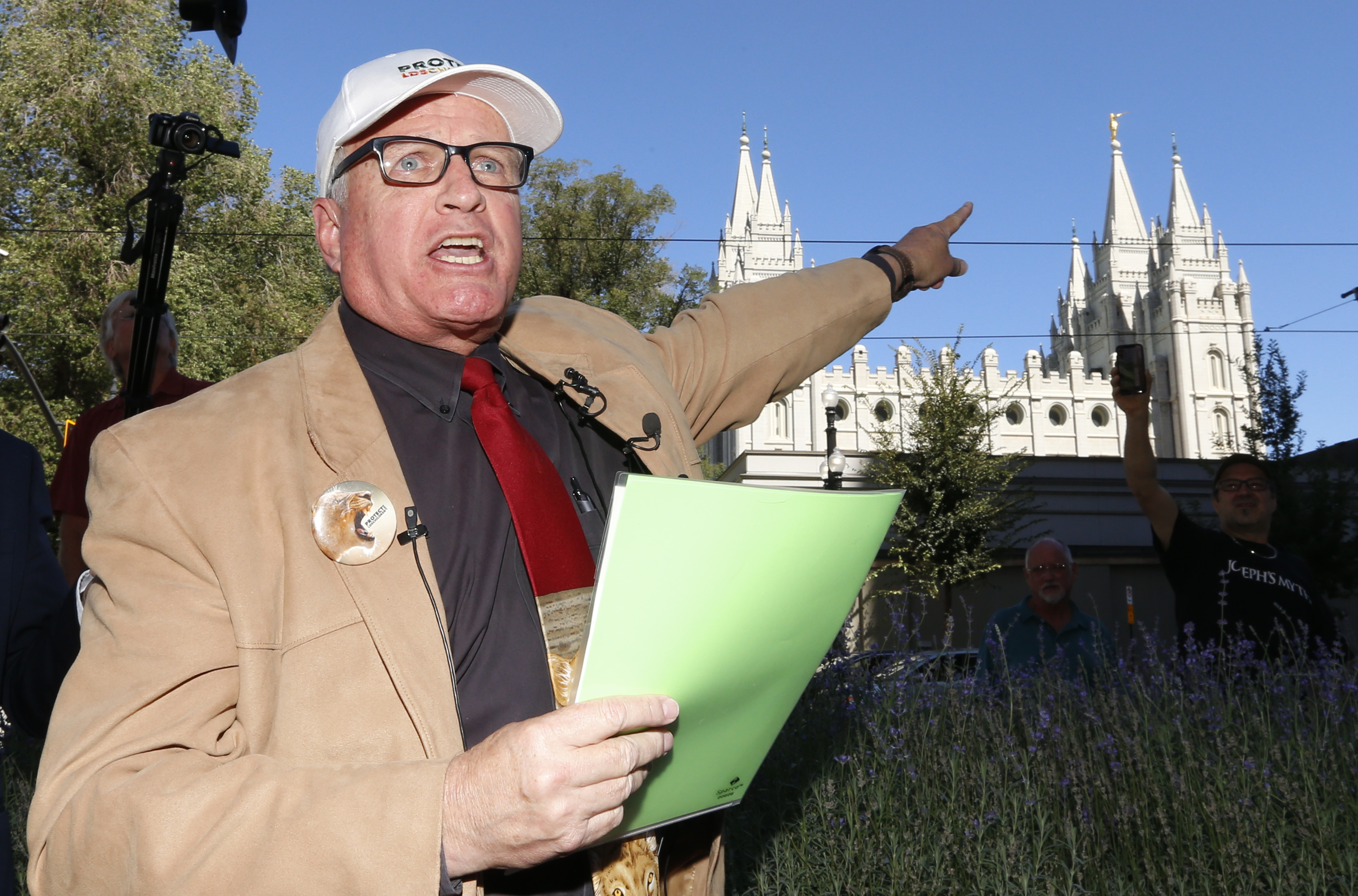 (AP Photo/Rick Bowmer) Sam Young speaks during a news conference Sunday, Sept. 16, 2018, in Salt Lake City. Young, a Mormon man who led a campaign criticizing the church's practice of allowing closed-door, one-on-one interviews of youths by lay leaders, has been kicked out of the faith. Young read a verdict letter for the first time Sunday that had been delivered to him following an earlier disciplinary hearing with local church leaders in Houston.