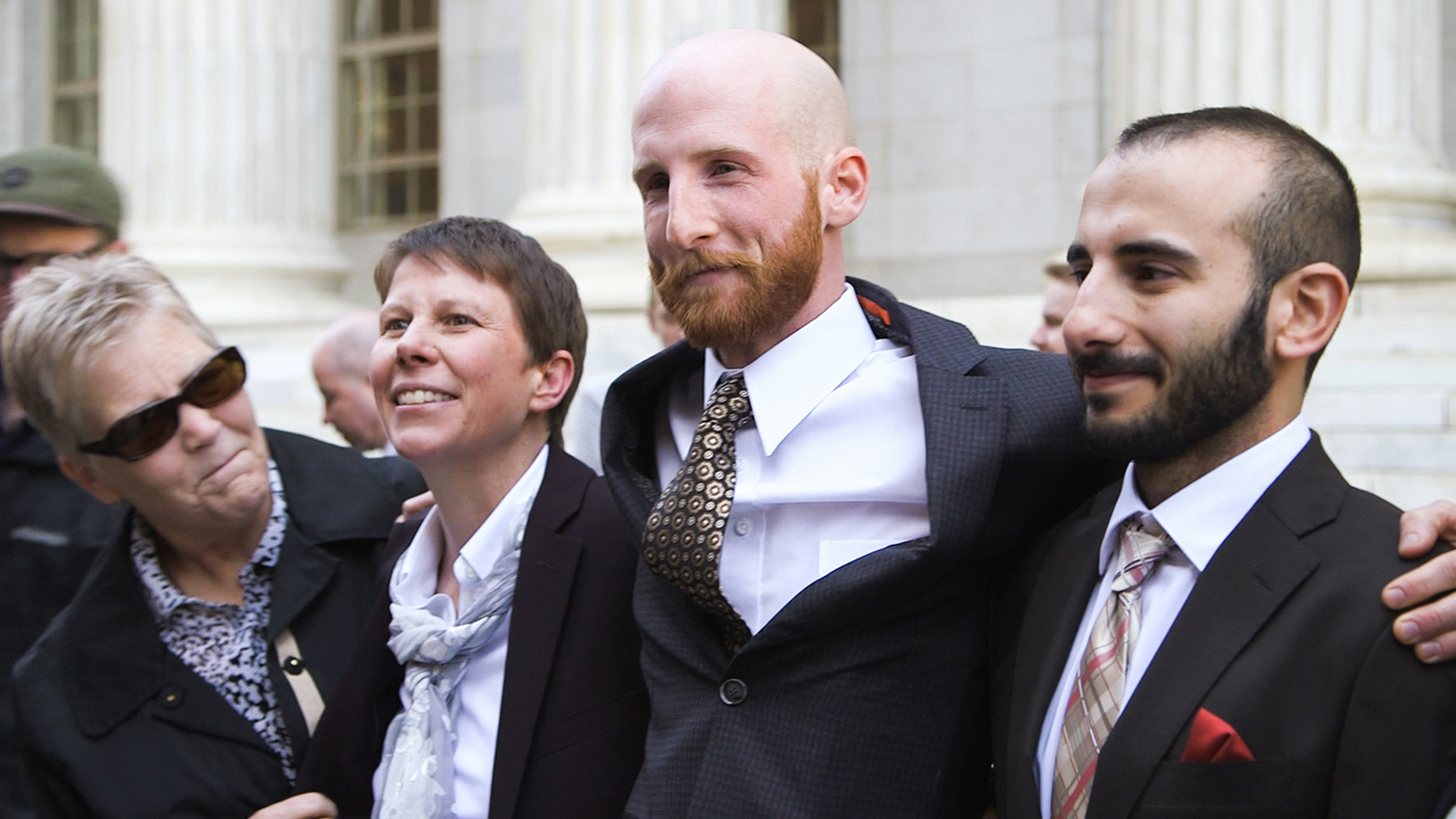 """(Photo courtesy of Blue Fox Entertainment) The plaintiffs in Kitchen v. Herbert, the legal case that made same-sex marriage legal in Utah, gather outside the 10th Circuit Court of Appeals in Denver in 2014, in a scene from the documentary """"Church & State."""" The plaintiffs are (from left): Laurie Wood, Kody Partridge, Derek Kitchen and Moudi Sbeity."""