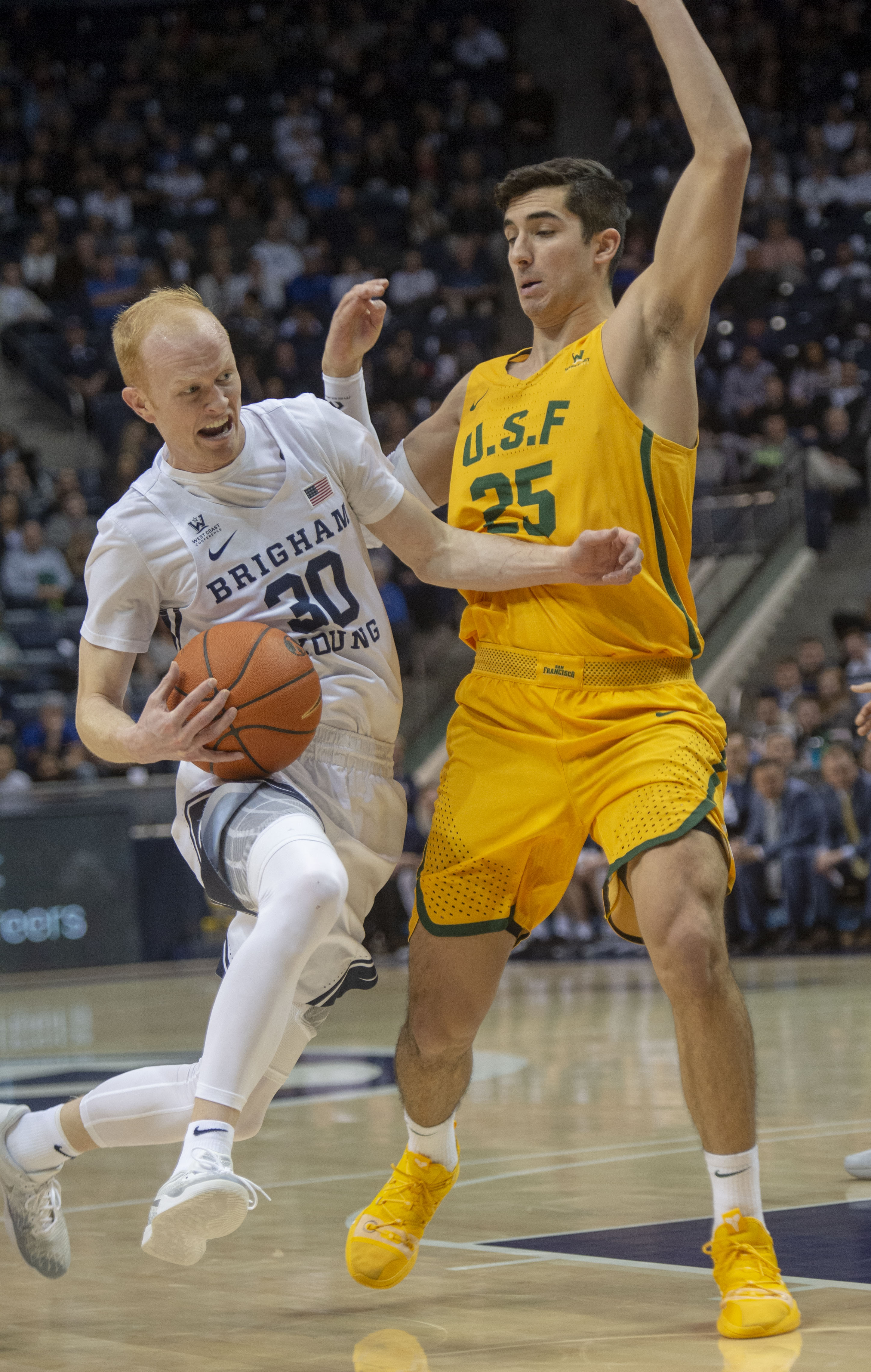 (Rick Egan  |  The Salt Lake Tribune)  Brigham Young Cougars guard TJ Haws (30) takes the ball inside as San Francisco Dons guard Jordan Ratinho (25) defends, in WCC basketball action at the Marriott Center, Thursday, February 21, 2018.