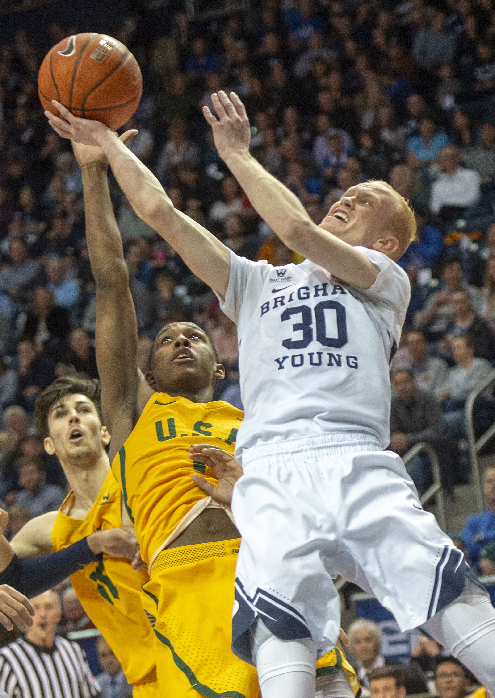 (Rick Egan  |  The Salt Lake Tribune)  Brigham Young Cougars guard TJ Haws (30) takes a shot as San Francisco Dons guard Jamaree Bouyea (1), in WCC basketball action at the Marriott Center, Thursday, February 21, 2018.