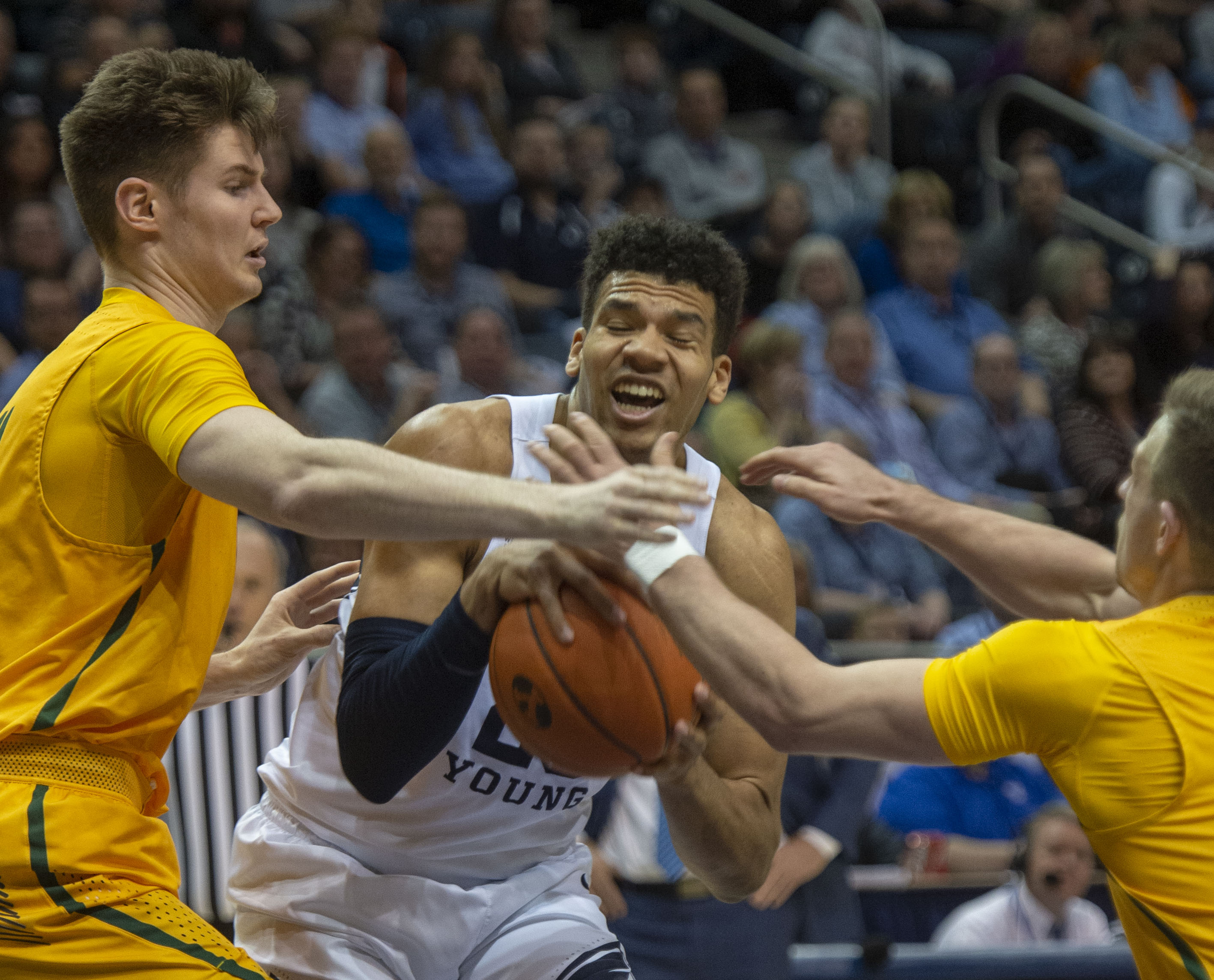 (Rick Egan  |  The Salt Lake Tribune)      Brigham Young Cougars forward Yoeli Childs (23) is doubled teamed by the San Francisco Dons, in WCC basketball action at the Marriott Center, Thursday, February 21, 2018.
