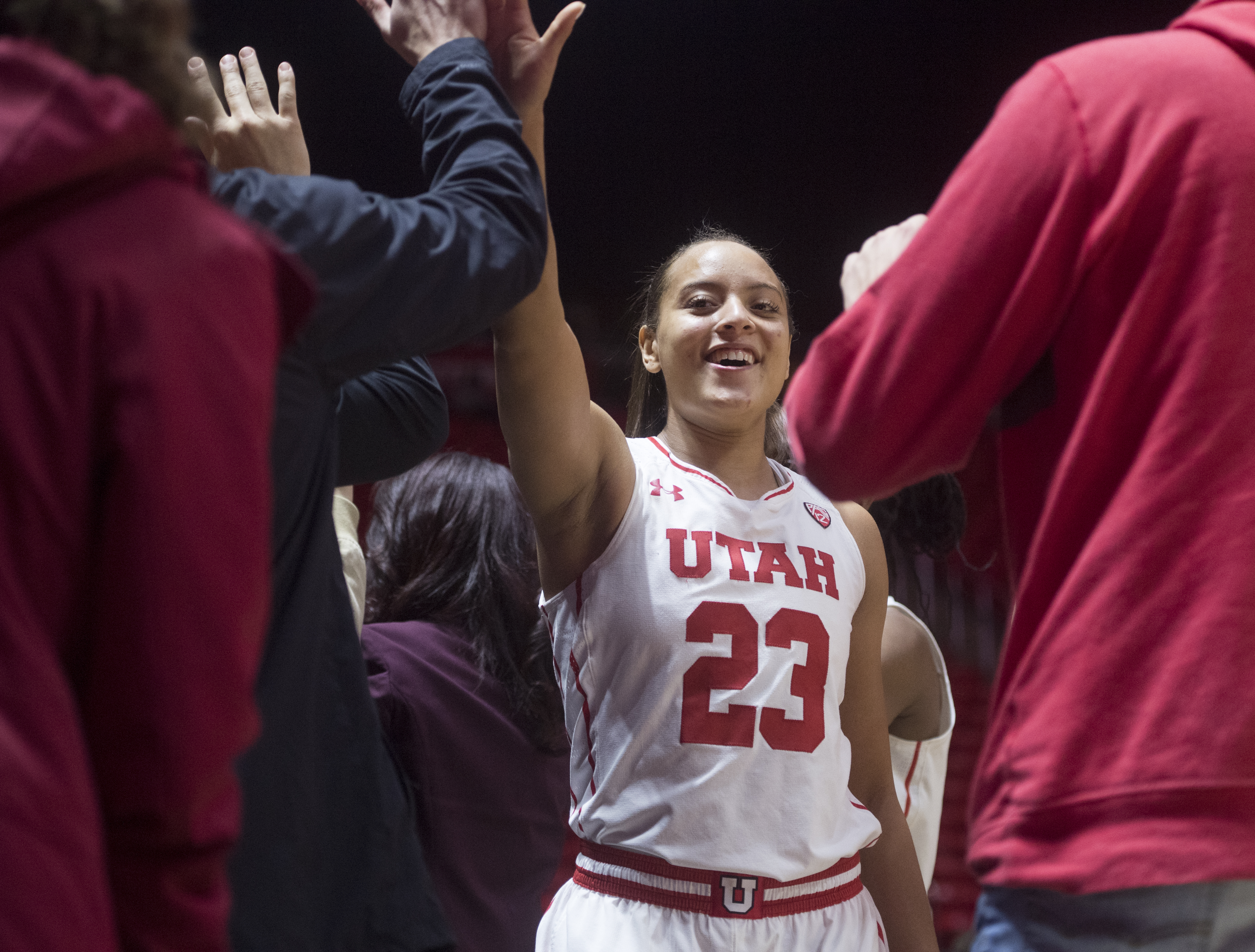 (Rick Egan  |  The Salt Lake Tribune)  Utah Utes guard/forward Daneesha Provo (23) high- fives fans after the Utes defeated the Boilermakers 81-68, in basketball action Utah Utes vs. Purdue Boilermakers, at the Thomas M. Huntsman Center, Monday, November 20, 2017.