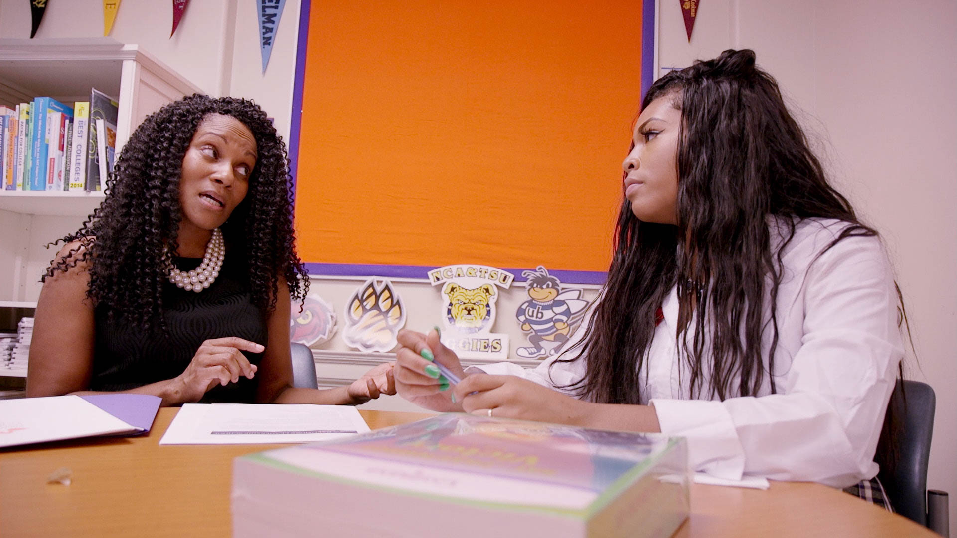 "(  | courtesy Fox Searchlight Pictures) Paula Dofat (left), counselor at the Baltimore Leadership School for Young Women, talks with student Blessin Giraldo, in a moment from the documentary ""Step."""