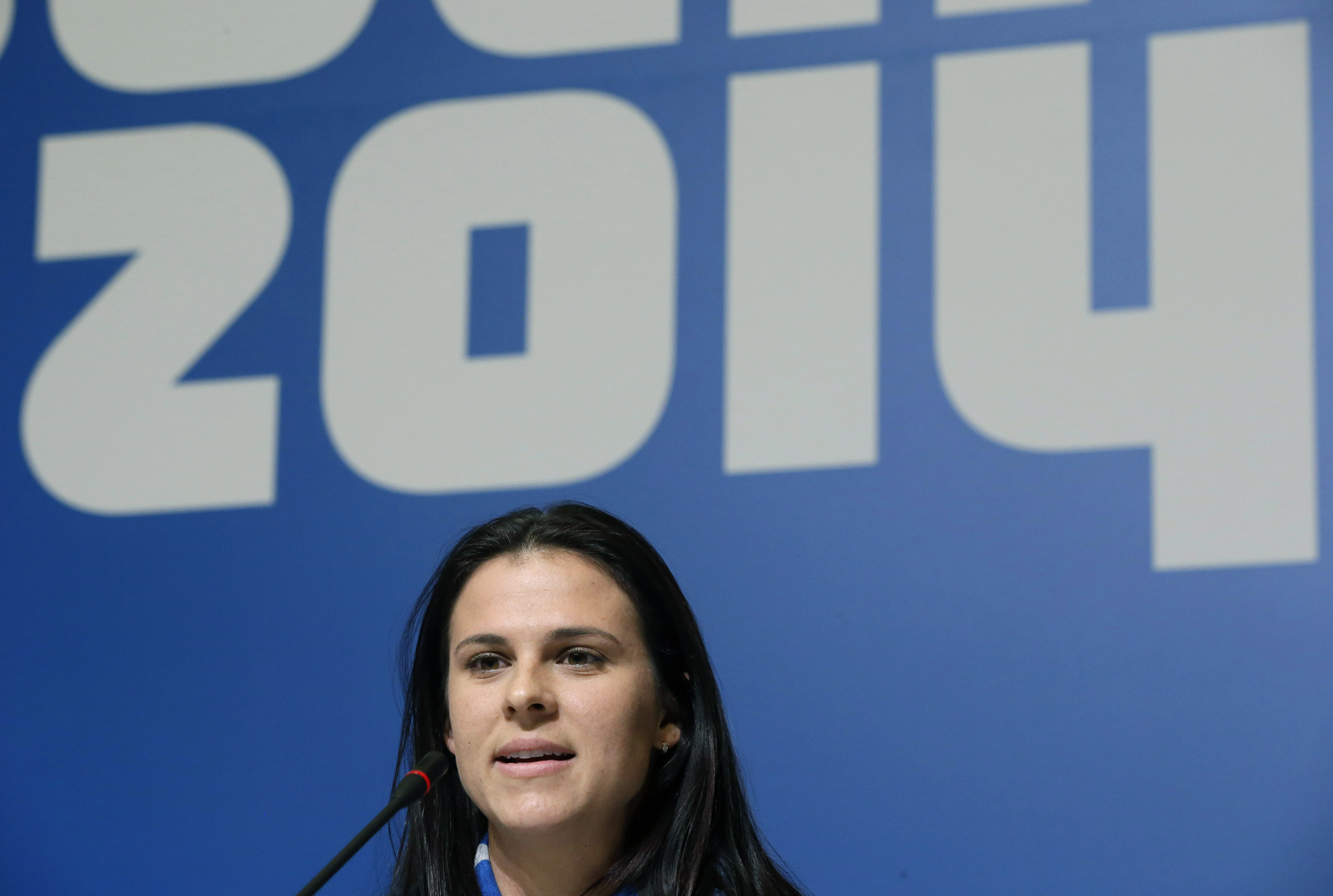 U.S. speedskater Brittany Bowe speaks during a 2014 Winter Olympics news conference, Thursday, Feb. 6, 2014, in Sochi, Russia. (AP Photo/Patrick Semansky)