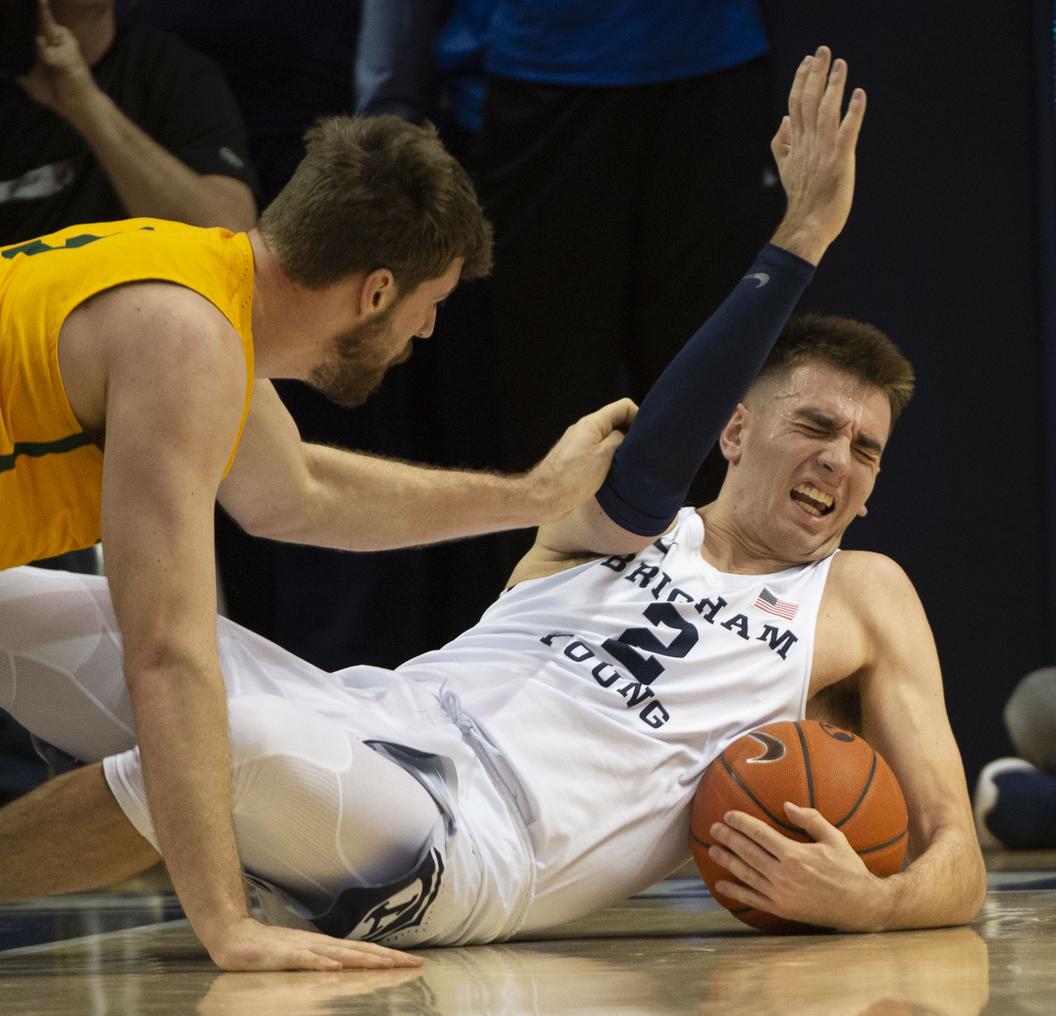 (Rick Egan  |  The Salt Lake Tribune)      San Francisco Dons center Jimbo Lull (5) goes for a loose ball along with Brigham Young Cougars guard Zac Seljaas (2), in WCC basketball action at the Marriott Center, Thursday, February 21, 2018.