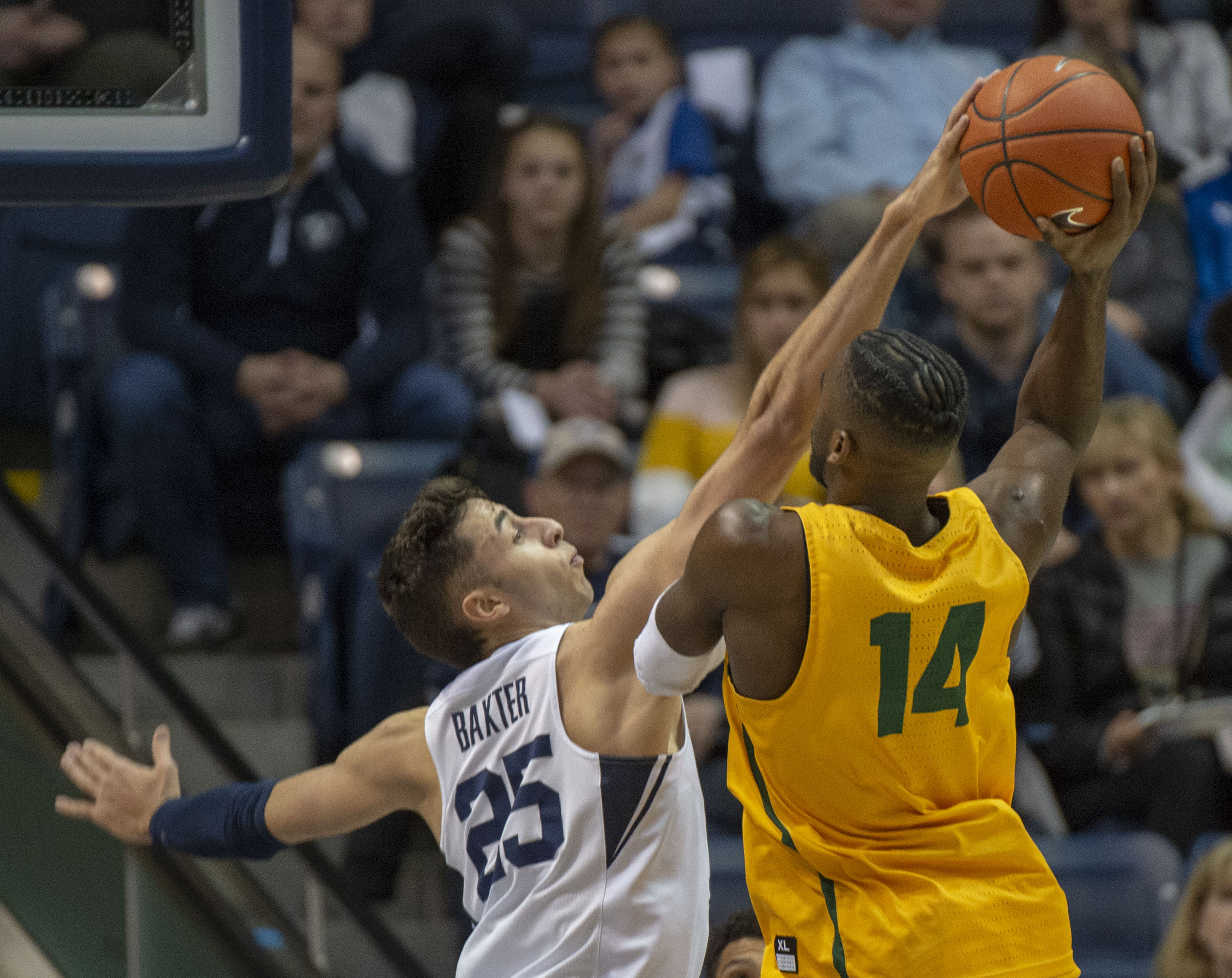 (Rick Egan  |  The Salt Lake Tribune)  Brigham Young Cougars forward Gavin Baxter (25) blocks a shot by San Francisco Dons guard Charles Minlend (14), in WCC basketball action at the Marriott Center, Thursday, February 21, 2018.