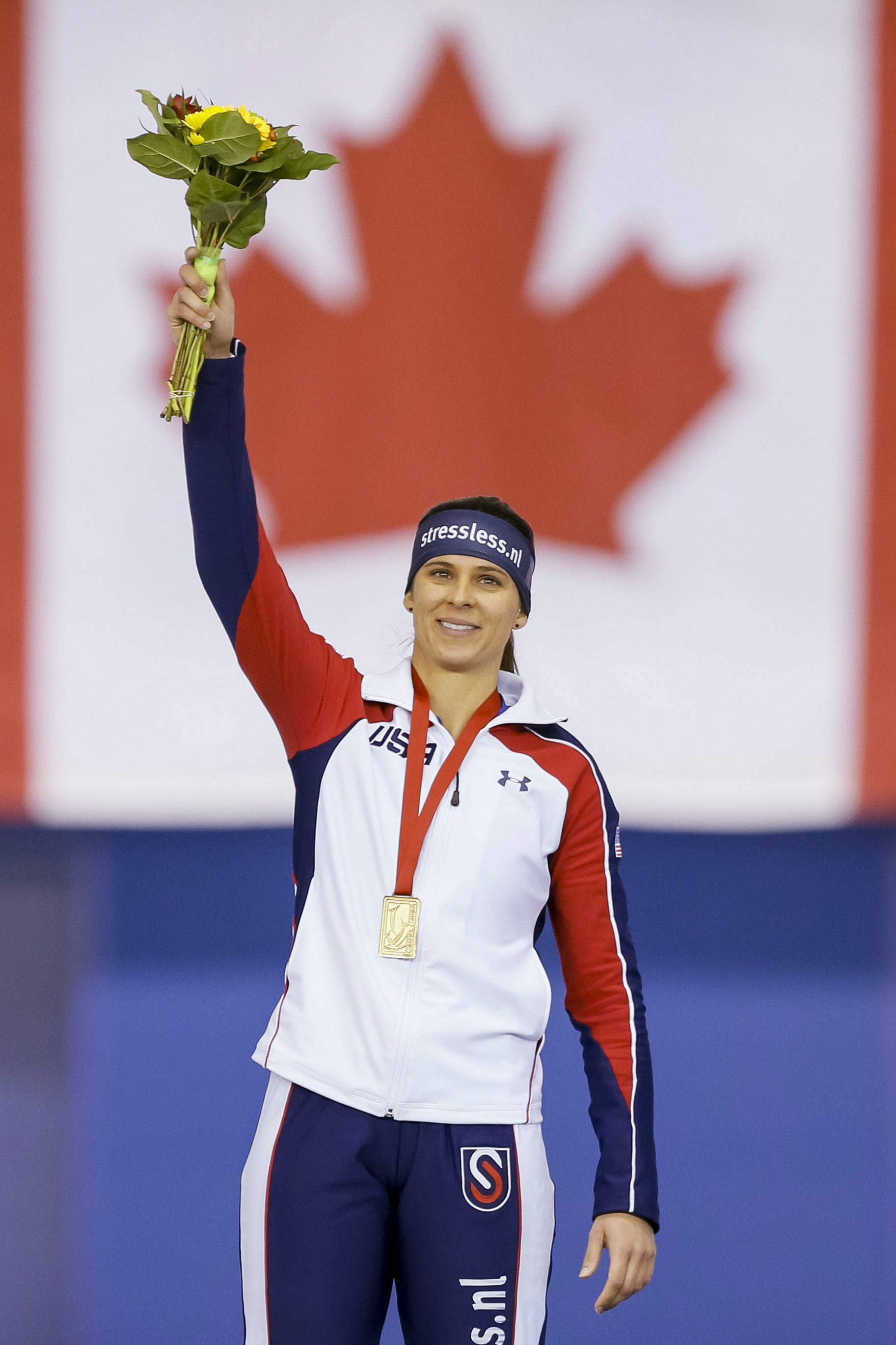 Brittany Bowe, of the United States, waves atop the podium after skating to a new world record of 1 minute, 51:59 seconds during the women's 1,500 meters at the World Cup speedskating event in Calgary, Alberta, Sunday, Nov. 15, 2015. (Lyle Aspinall/The Canadian Press via AP)