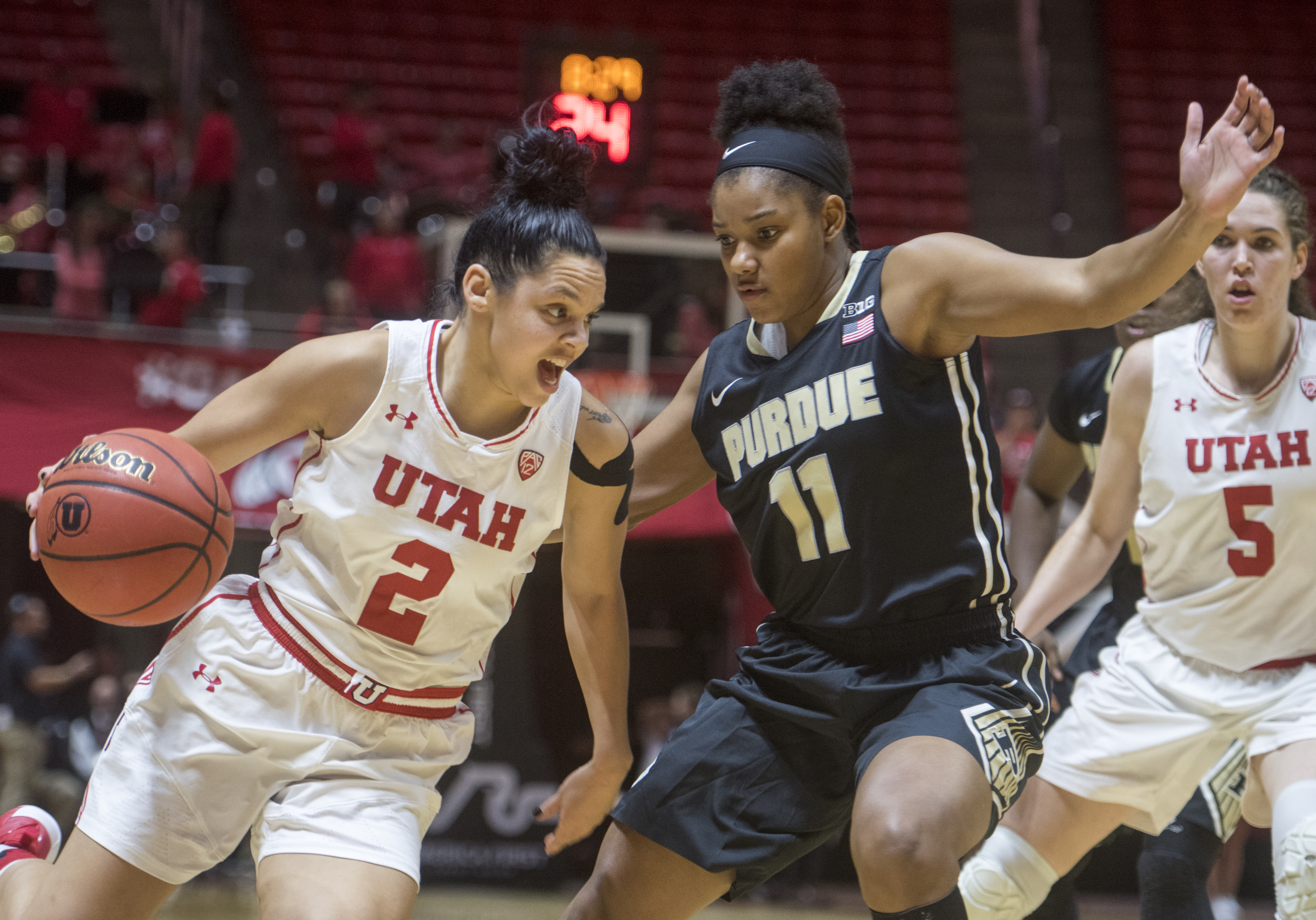(Rick Egan  |  The Salt Lake Tribune)  Utah Utes guard Tori Williams (2) drives inside with the ball, as Purdue Boilermakers guard Dominique Oden (11) defends, in basketball action Utah Utes vs. Purdue Boilermakers, at the Thomas M. Huntsman Center, Monday, November 20, 2017.