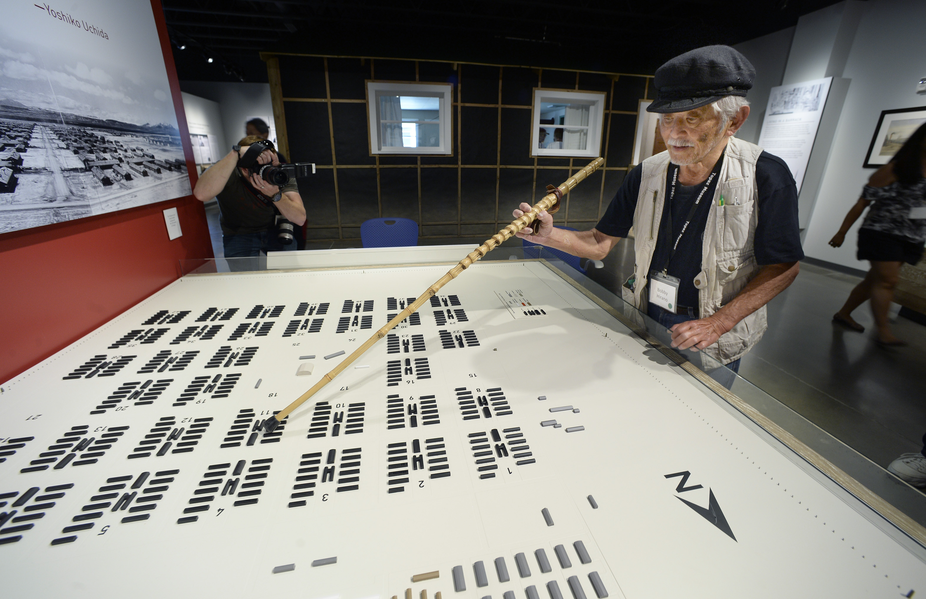 (Scott Sommerdorf   |  The Salt Lake Tribune)  83-year-old Bobby Hirano, who lived in the Topaz Internment Camp as a 10-year-old boy, uses his cane to point at the barrack in Block 11 during the grand opening of the Topaz Museum in Delta, Saturday, July 8, 2017.