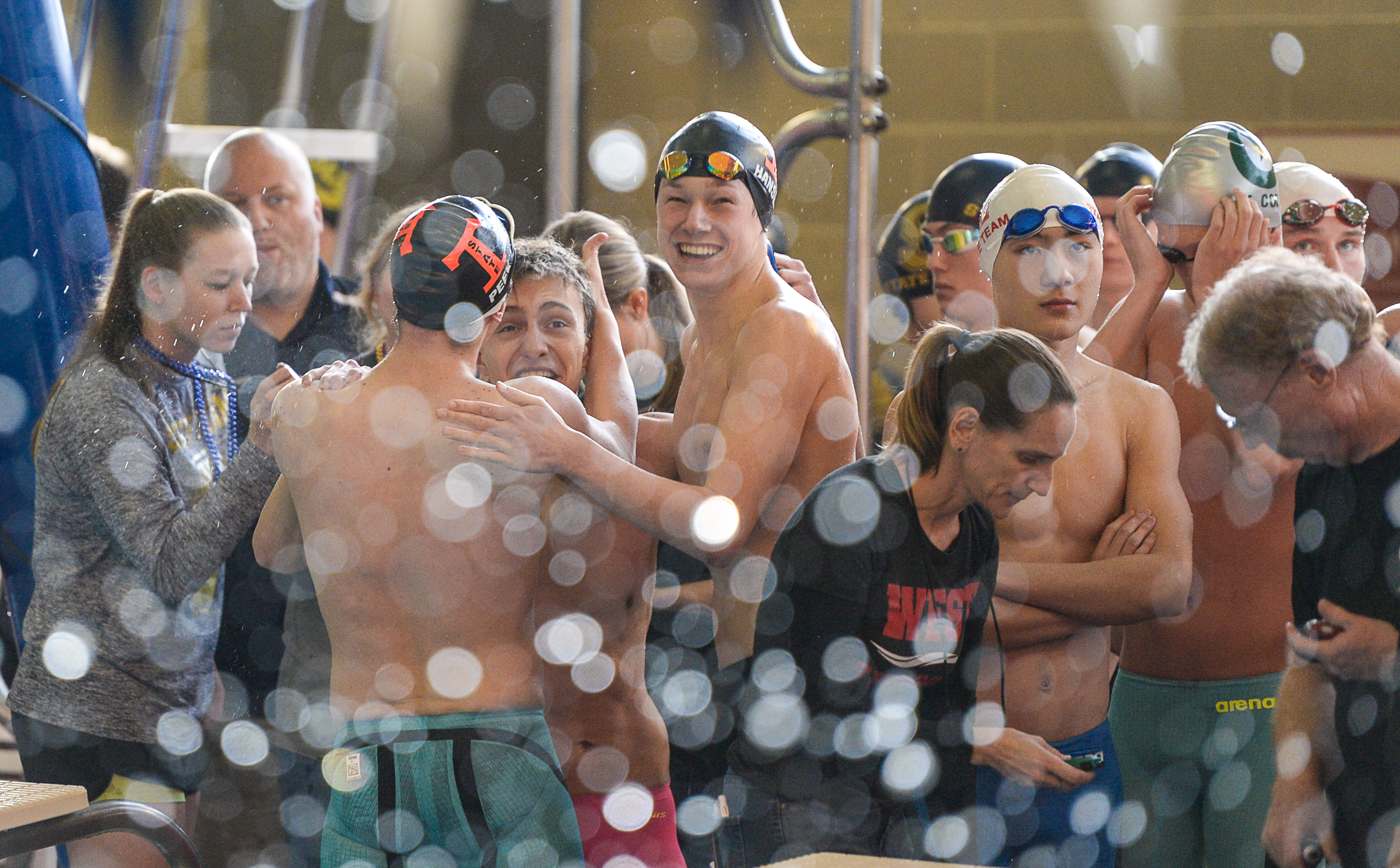 (Francisco Kjolseth  |  The Salt Lake Tribune)  Teams celebrate while competing in the Men 200 Yard Medley at the high school swimming 5A State Championships in Bountiful, Friday February 9, 2018.