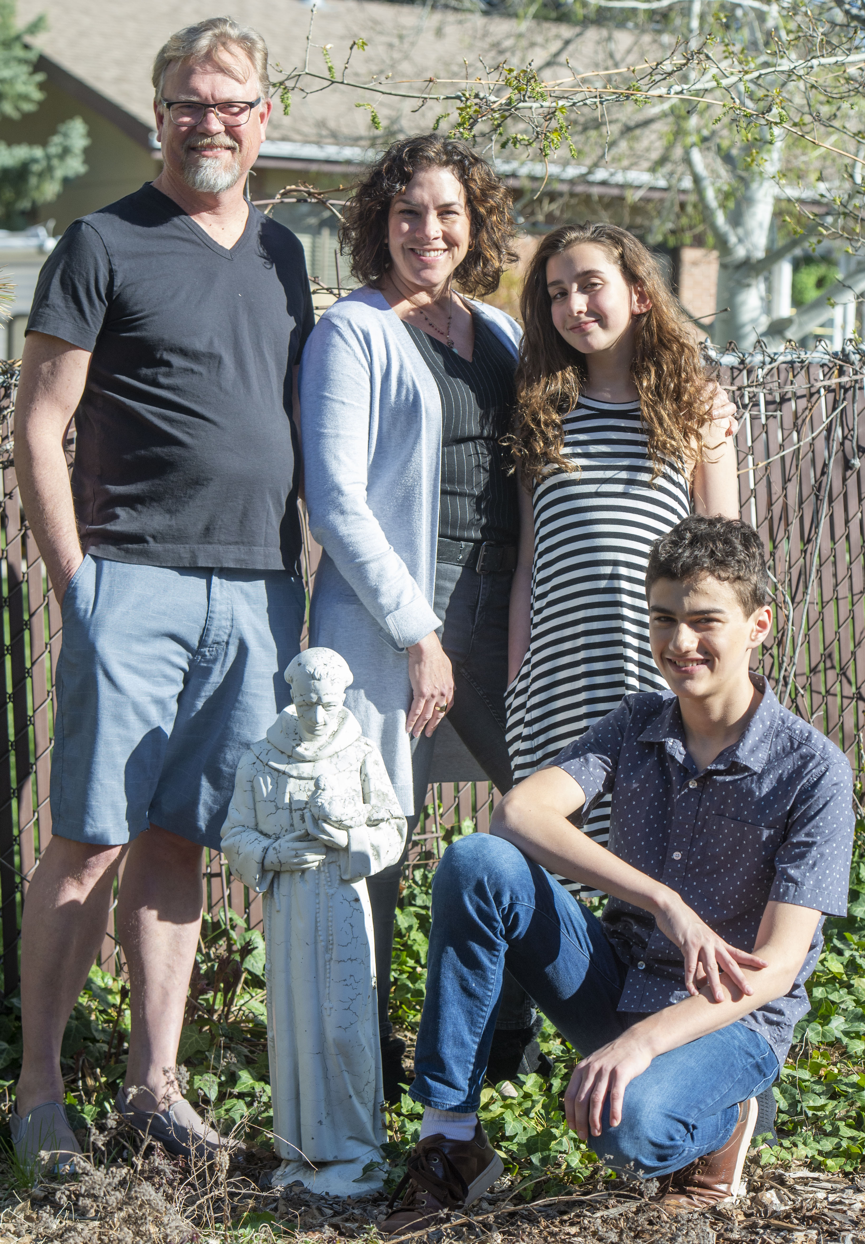 (Rick Egan  |  The Salt Lake Tribune)    Stephen Washburn, April Washburn, Zoe Dobiner, and Aiden Dobiner, by a statue of St. Francis in their front garden.  Stephen and April Washburn are an interfaith couple. He is Episcopalian, she's Jewish. Thursday, April 18, 2019.