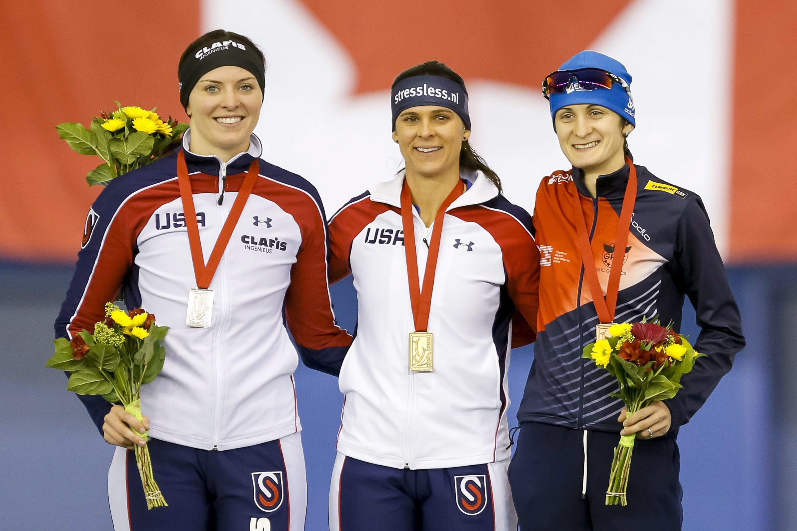 Second-place Heather Bergsman. left; winner Brittany Bowe, both of the United States; and third-place Martina Sablikova, of the Czech Republic, share the podium after the women's 1,500 meters at the World Cup speedskating event in Calgary, Alberta, Sunday, Nov. 15, 2015. (Lyle Aspinall/The Canadian Press via AP)