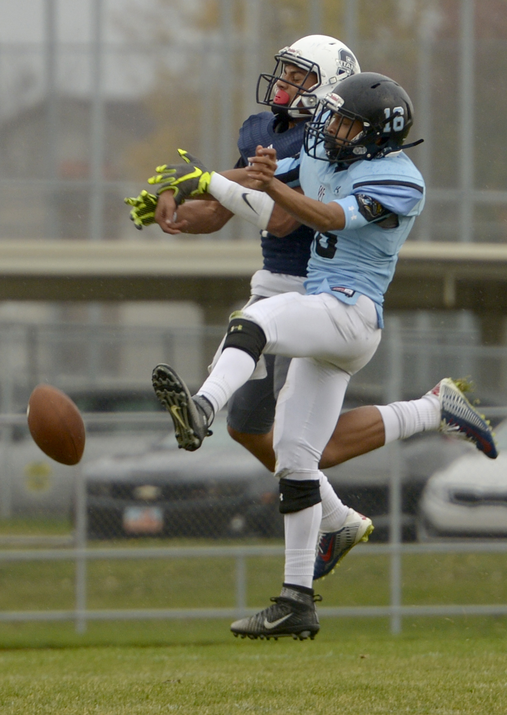 Leah Hogsten  |  The Salt Lake Tribune Pass intended for Syracuse's NJ Mo'o is knocked down by West Jordan's Adrian Moctezuma.  Syracuse High School  battles West Jordan High School in the opening round of the Class 5A football playoffs, Friday, October 28, 2016.