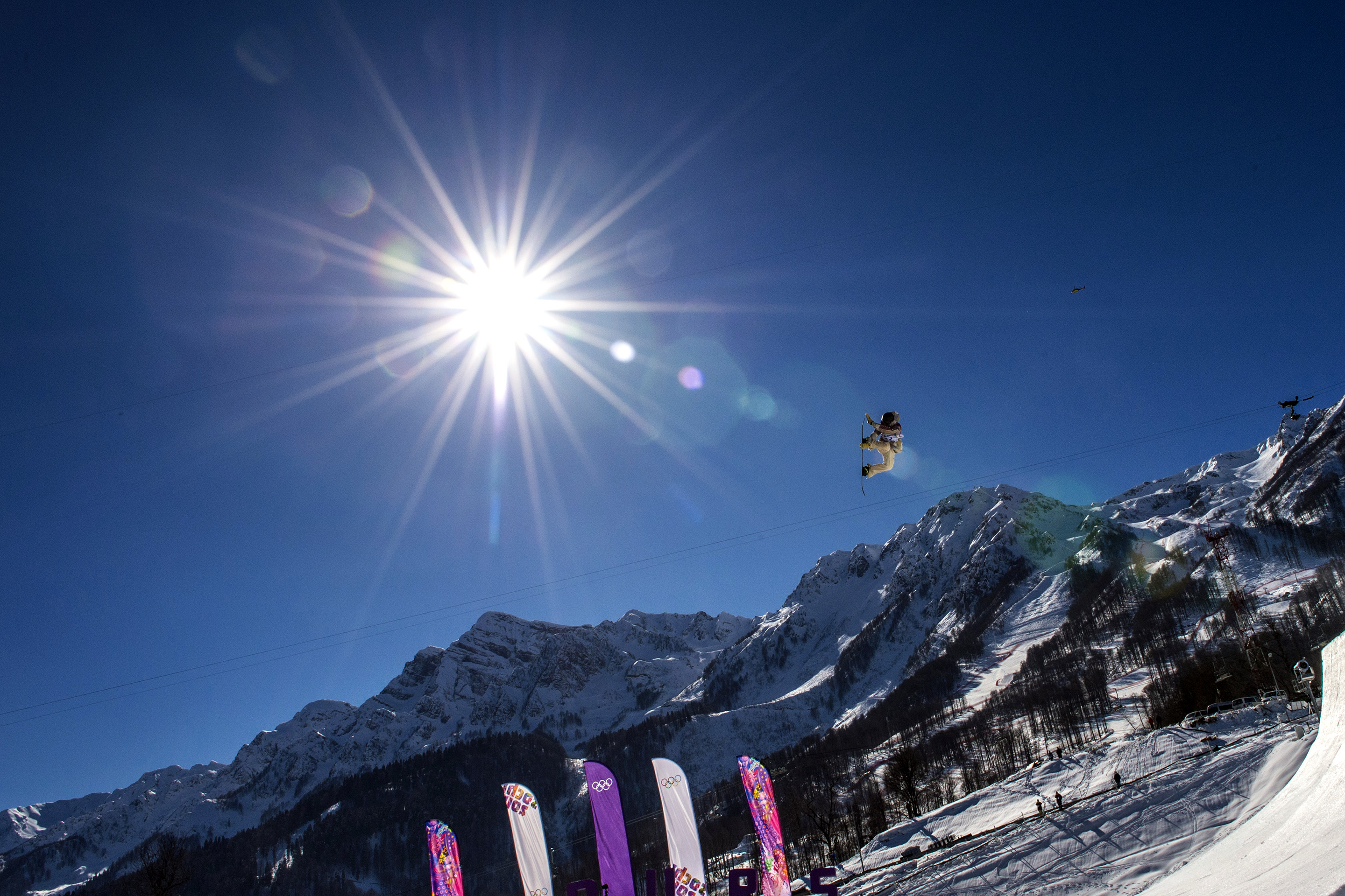 Sage Kotsenburg, of Park City, competes in the men's slopestyle finals at the Rosa Khutor Extreme Park during the 2014 Sochi Olympic Games. Kotsenburg won the gold medal with a score of 93.50.  (Photo by Chris Detrick/The Salt Lake Tribune)