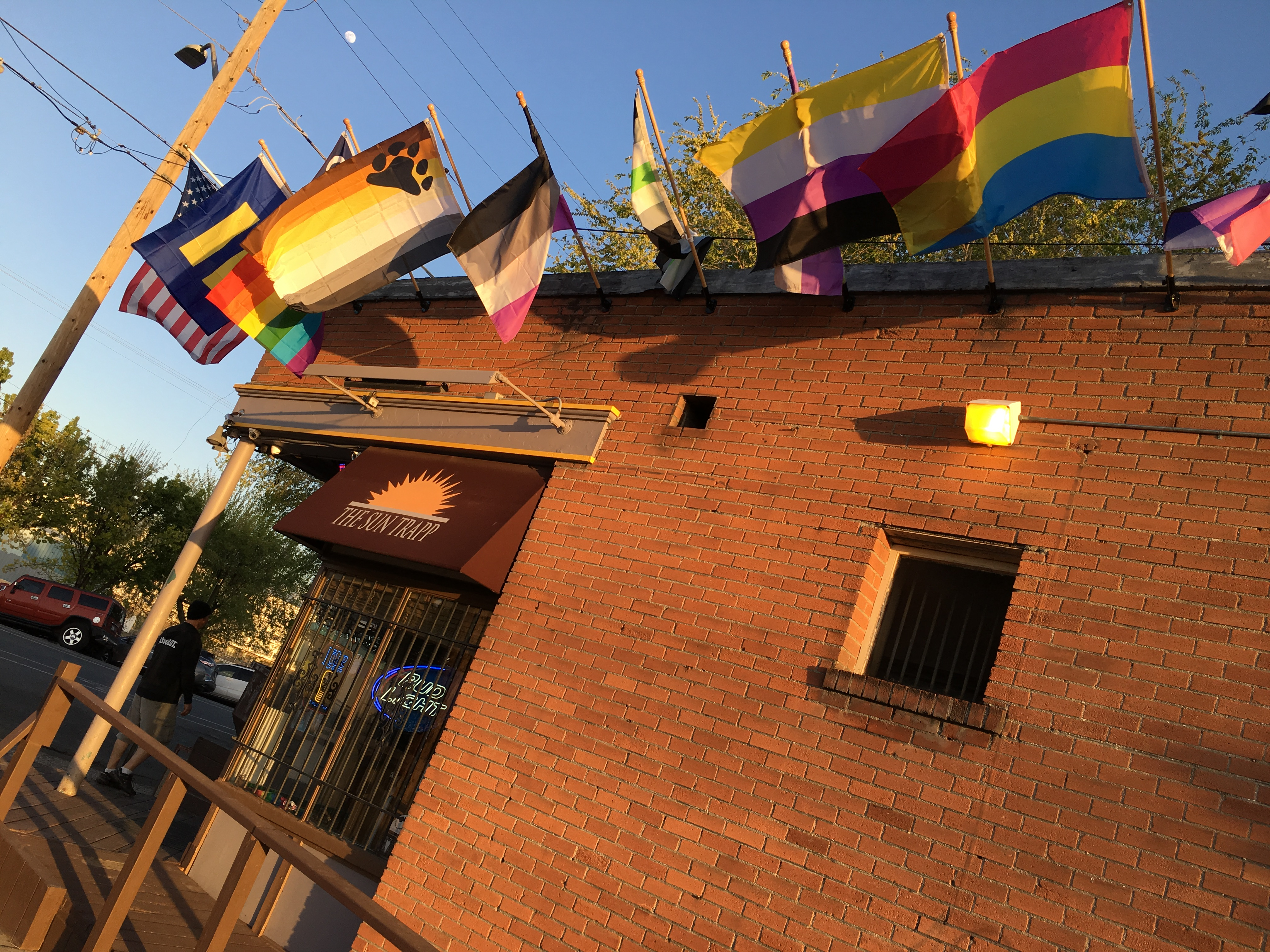 Flags outside Salt Lake City gay bar the Sun Trapp, representing many facets of LGBT culture.