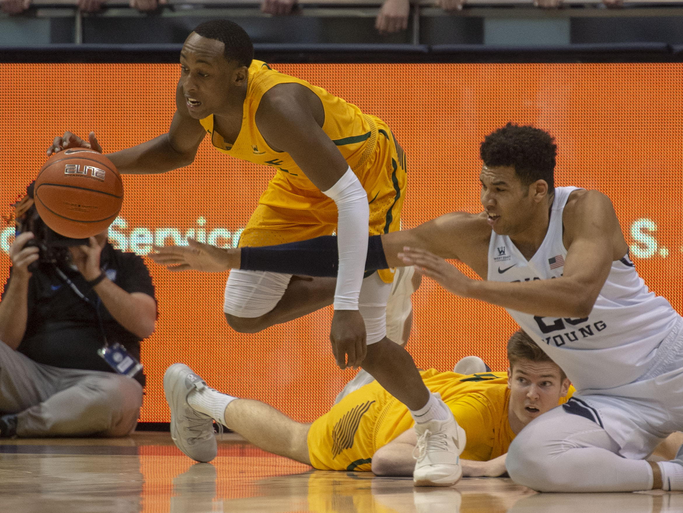 (Rick Egan  |  The Salt Lake Tribune)  Brigham Young Cougars forward Yoeli Childs (23) goes for a loose ball along with San Francisco Dons guard Jamaree Bouyea (1), in WCC basketball action at the Marriott Center, Thursday, February 21, 2018.