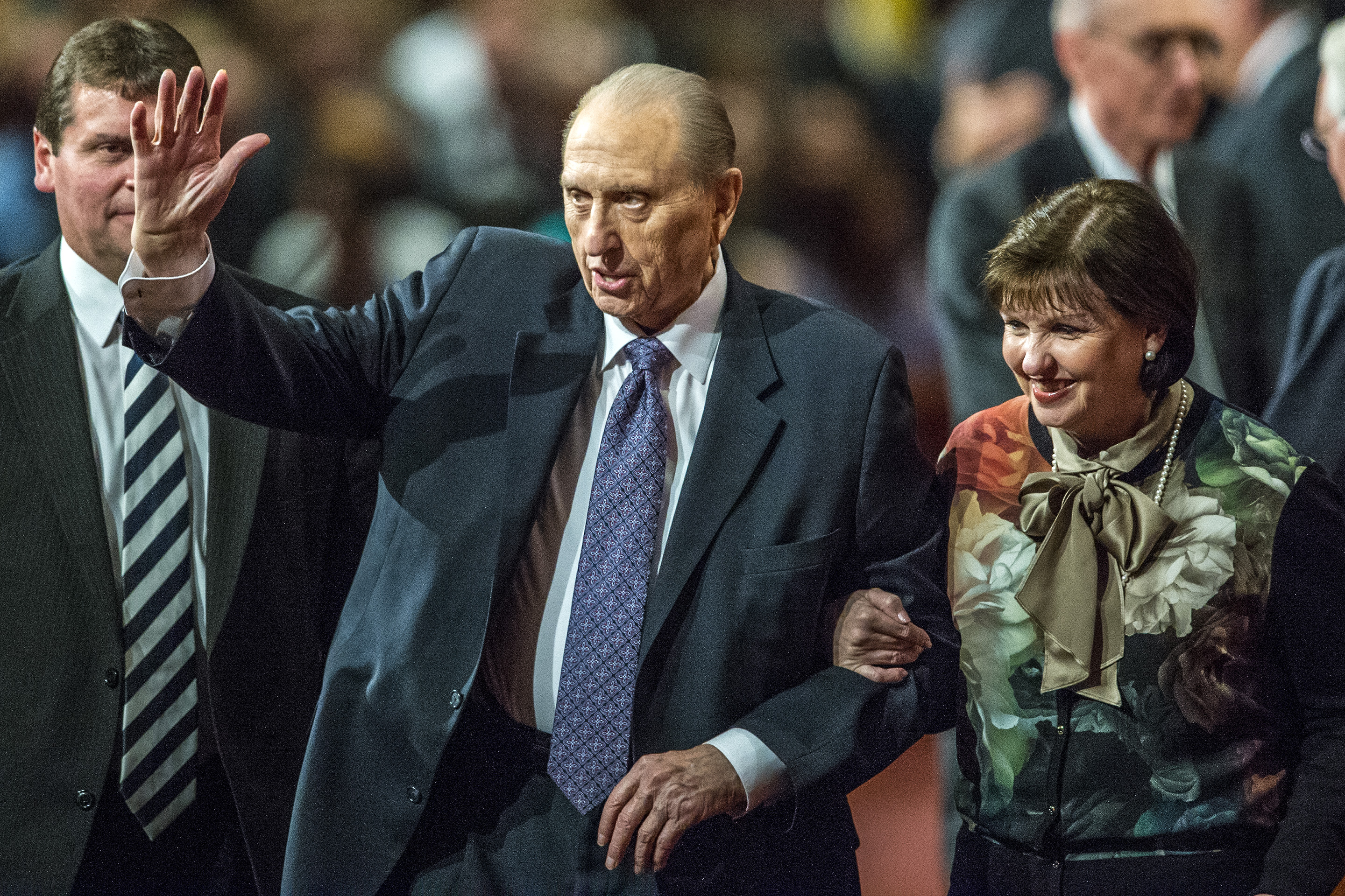 (Chris Detrick  |  The Salt Lake Tribune) President Thomas S. Monson walks off of the stage with his daughter, Ann M. Dibb, during afternoon session of the 185th Semiannual General Conference on Oct. 3, 2015.
