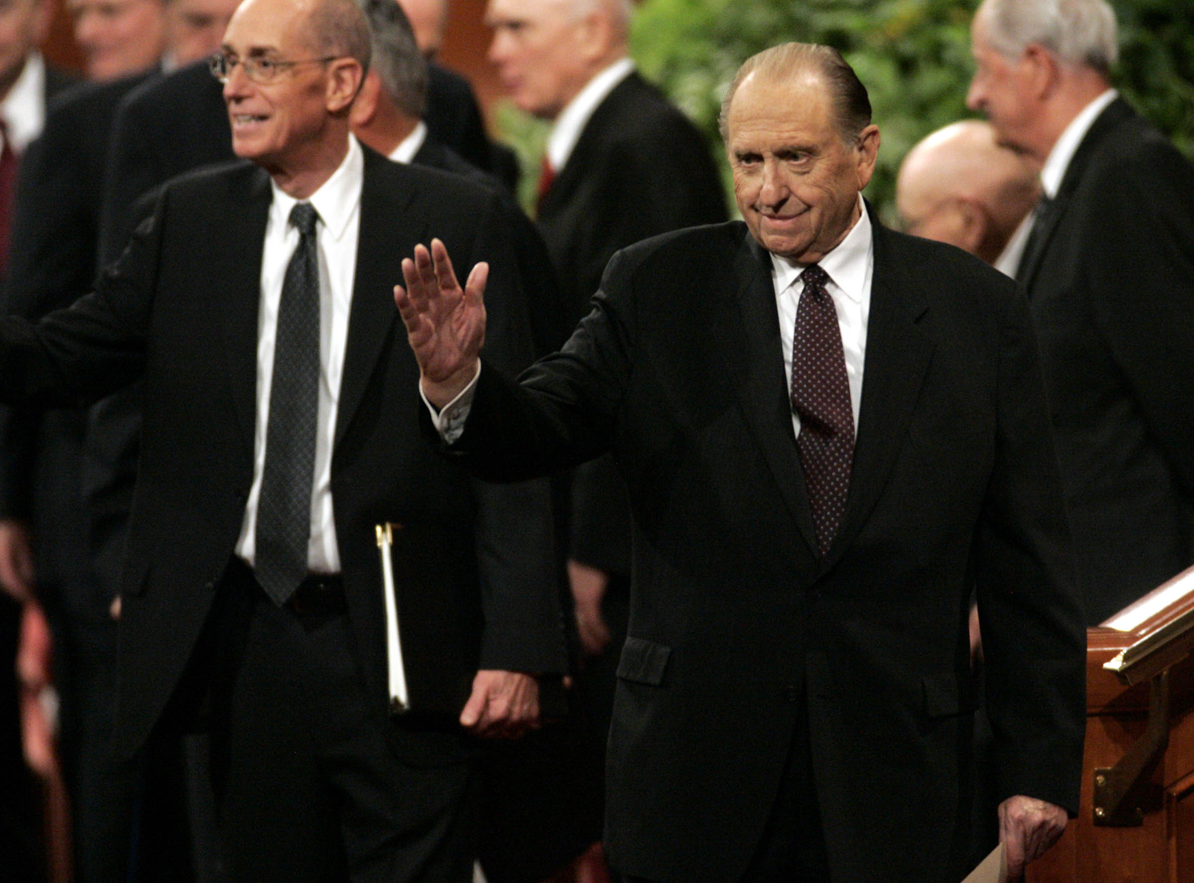 (Tribune file photo) LDS Church President Thomas Monson waves to the audience after speaking during the closing session of the LDS General Conference on October 5, 2008.