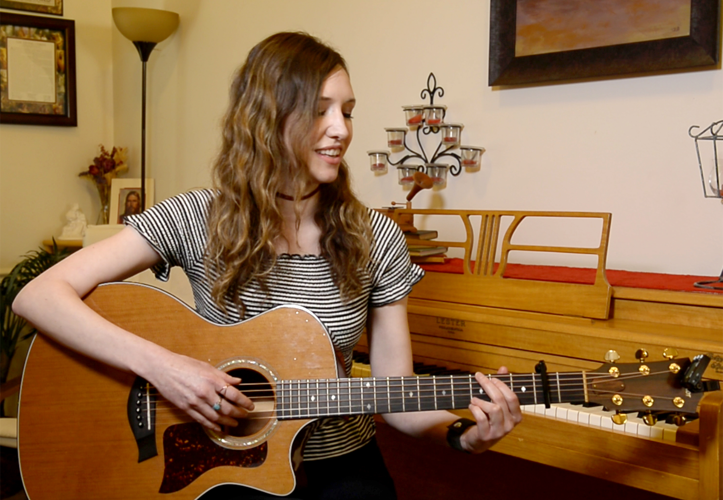 "(Rick Egan  |  The Salt Lake Tribune)     April Meservy plays the guitar at her home in Provo.  Meservy recorded a cover of U2's ""With or Without You""  with will be used by Canadian pairs figure skaters, Eric Radford, and Meagan Duhamel  as they perform at this year's Winter Olympic Games in PyeongChang, South Korea. Wednesday, February 7, 2018."