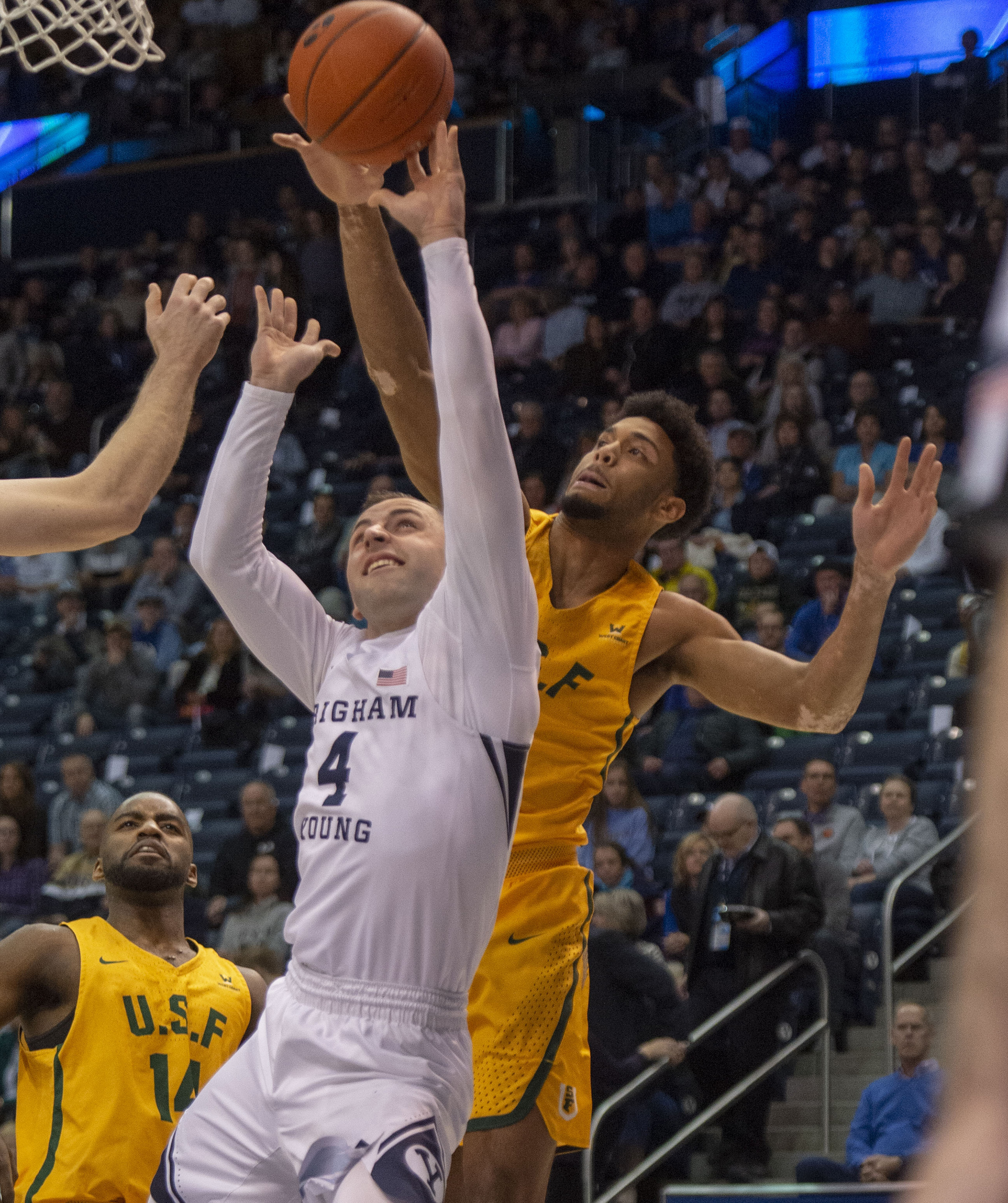 (Rick Egan  |  The Salt Lake Tribune)  San Francisco Dons forward Nate Renfro (15) blocks a shot by Brigham Young Cougars guard Nick Emery (4), in WCC basketball action at the Marriott Center, Thursday, February 21, 2018.