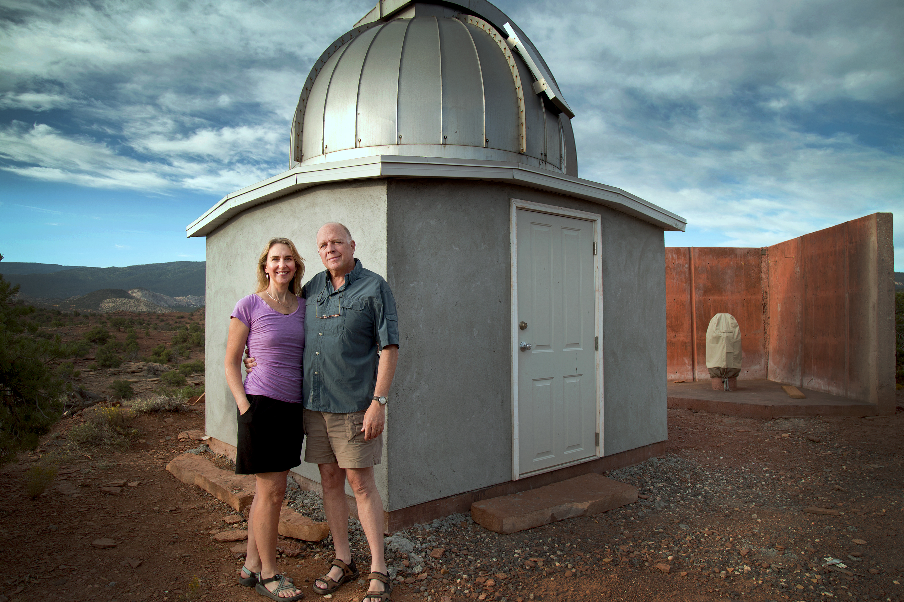 (Photo courtesy of Mark Bailey) Kirsten and Mark Bailey stand next to their Torrey House Alpenglow Observatory. The observatory is a gift from Mark's father that formerly occupied his back yard in Salt Lake City. The research-grade observatory is completely automated and can be operated remotely. Bailey now captures astrophotography with the telescope's CCD camera, recording photos of galaxies, stars and nebulae.