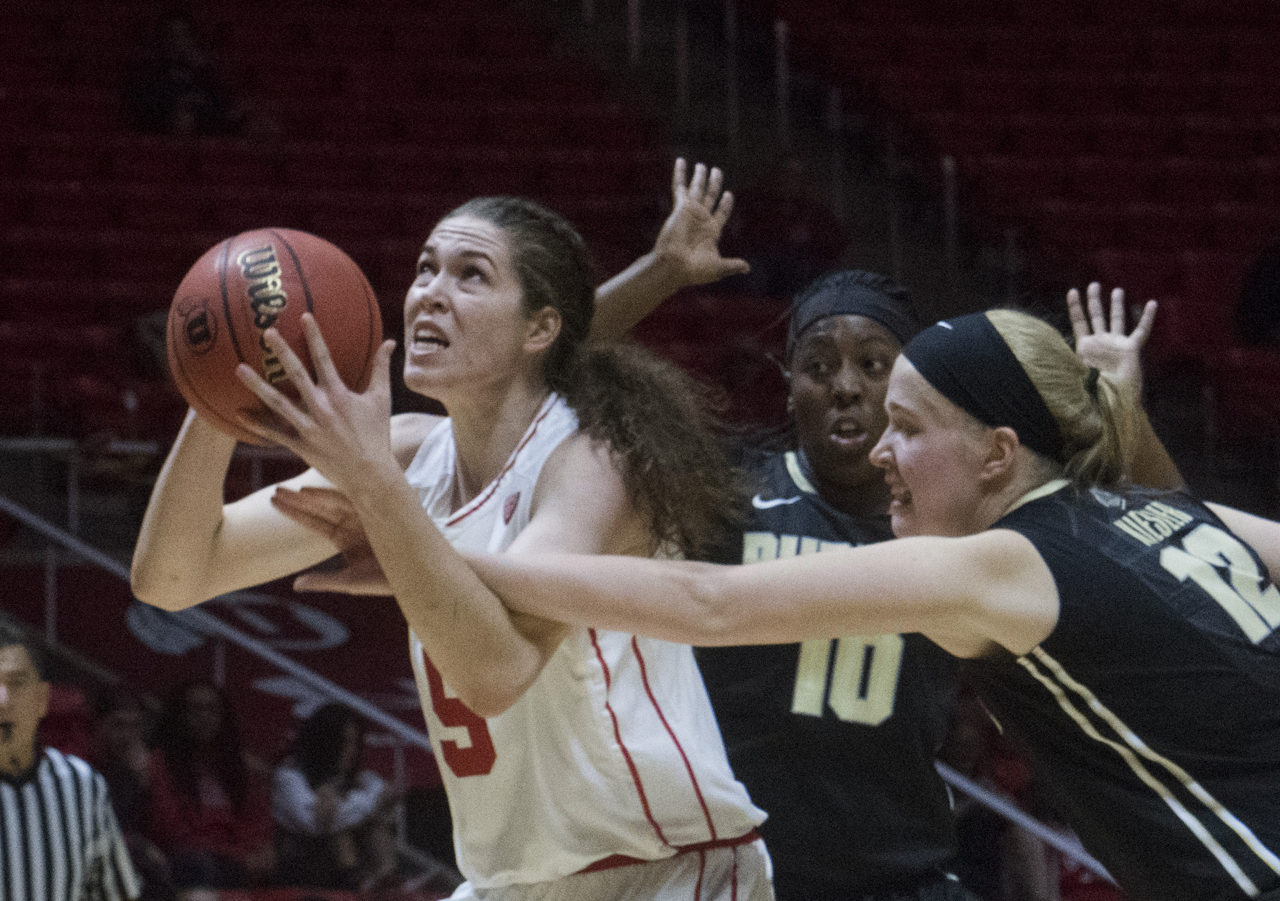 (Rick Egan  |  The Salt Lake Tribune)  Utah Utes center Megan Huff (5) is fouled by Purdue Boilermakers center Nora Kiesler (12) as she goes to the hoop, in basketball action Utah Utes vs. Purdue Boilermakers, at the Thomas M. Huntsman Center, Monday, November 20, 2017.