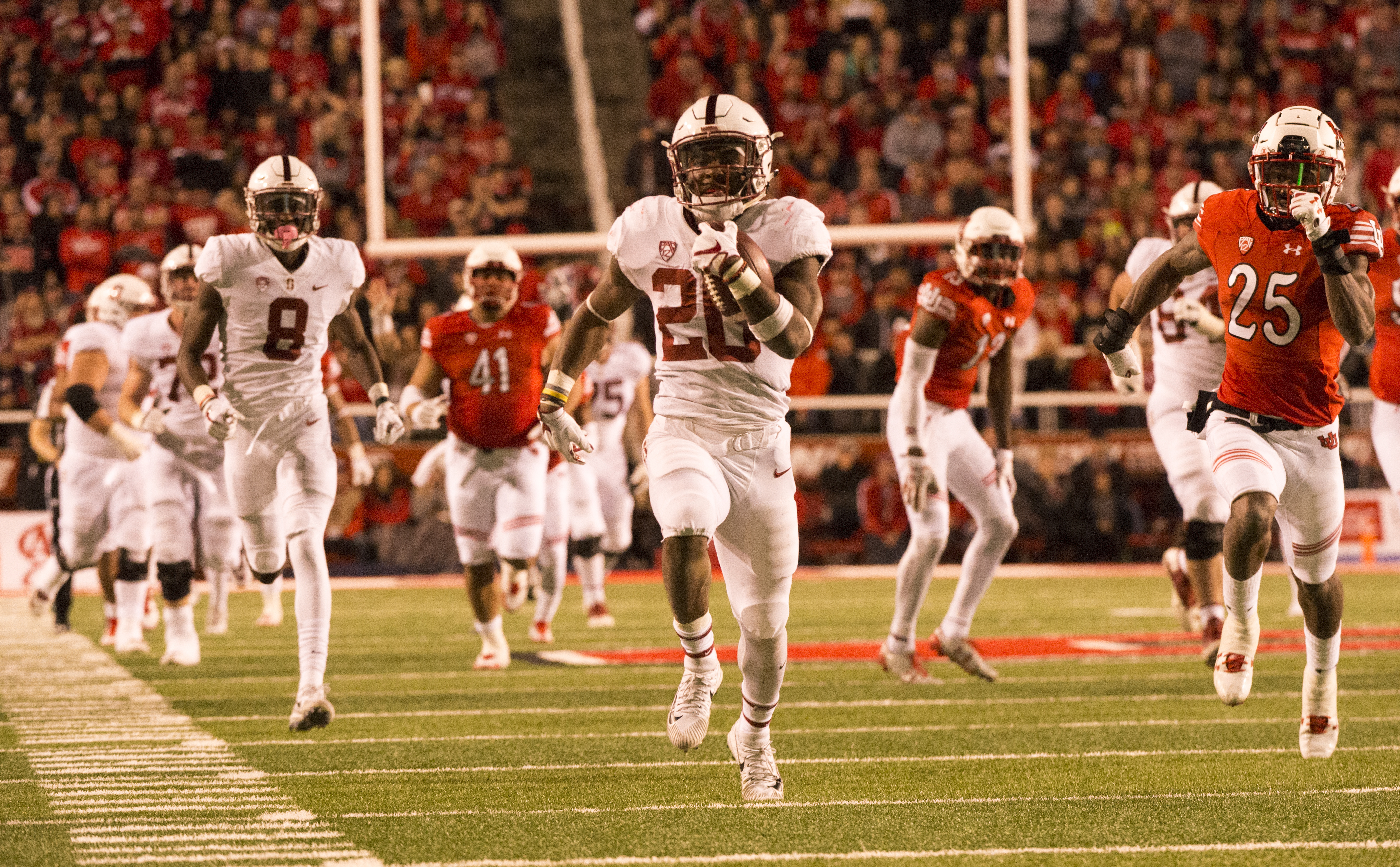 (Rick Egan  |  The Salt Lake Tribune)  Stanford Cardinal running back Bryce Love (20) runs for the winning touchdown, in PAC-12 football action, at Rice-Eccles Stadium, Saturday, October 7, 2017.