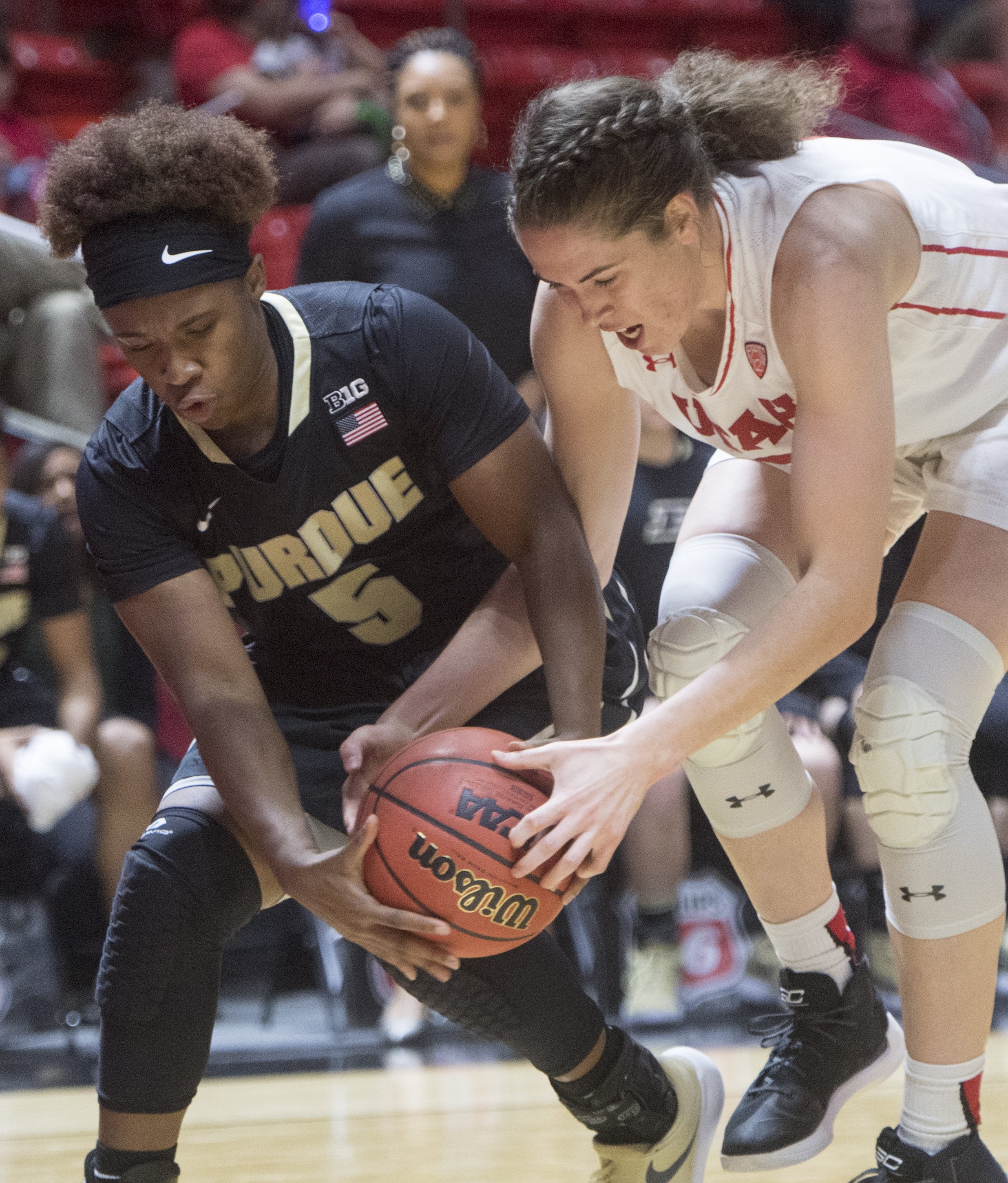 (Rick Egan  |  The Salt Lake Tribune)  Utah Utes forward Emily Potter (12) goes for the ball along with Purdue Boilermakers guard Miracle Gray (5), in basketball action Utah Utes vs. Purdue Boilermakers, at the Thomas M. Huntsman Center, Monday, November 20, 2017.