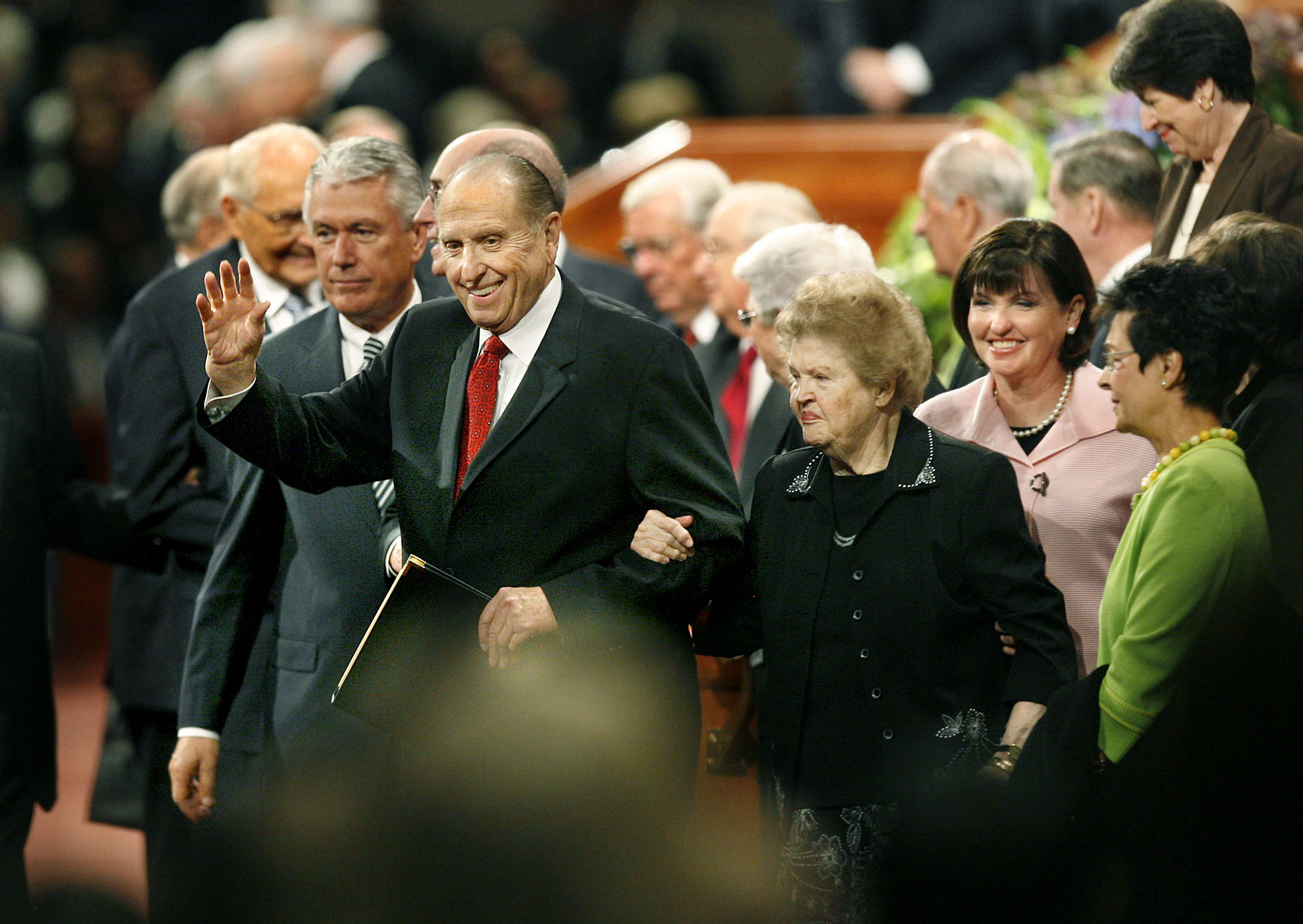 (Scott Sommerdorf  |  The Salt Lake Tribune) President Thomas S. Monson leaves the Conference Center with his wife, Frances, on his arm after the morning session of the 179th Semiannual General Conference in October 2009