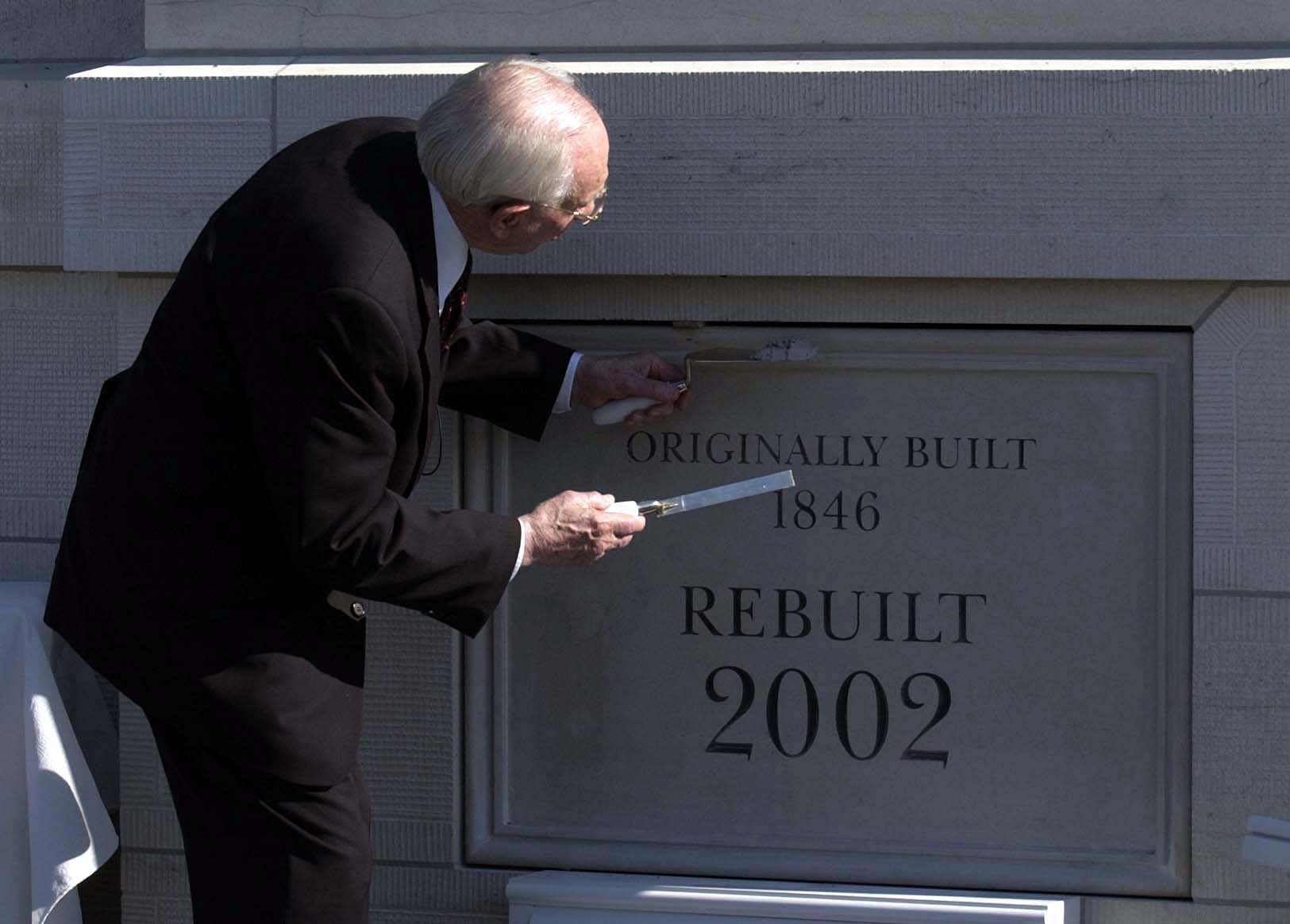 (Trent Nelson  |  Tribune file photo)  LDS Church President Gordon B. Hinckley seals a coverstone on the Nauvoo Temple, scheduled to be dedicated Thursday evening on the anniversary of the martyrdom of church founder Joseph Smith.