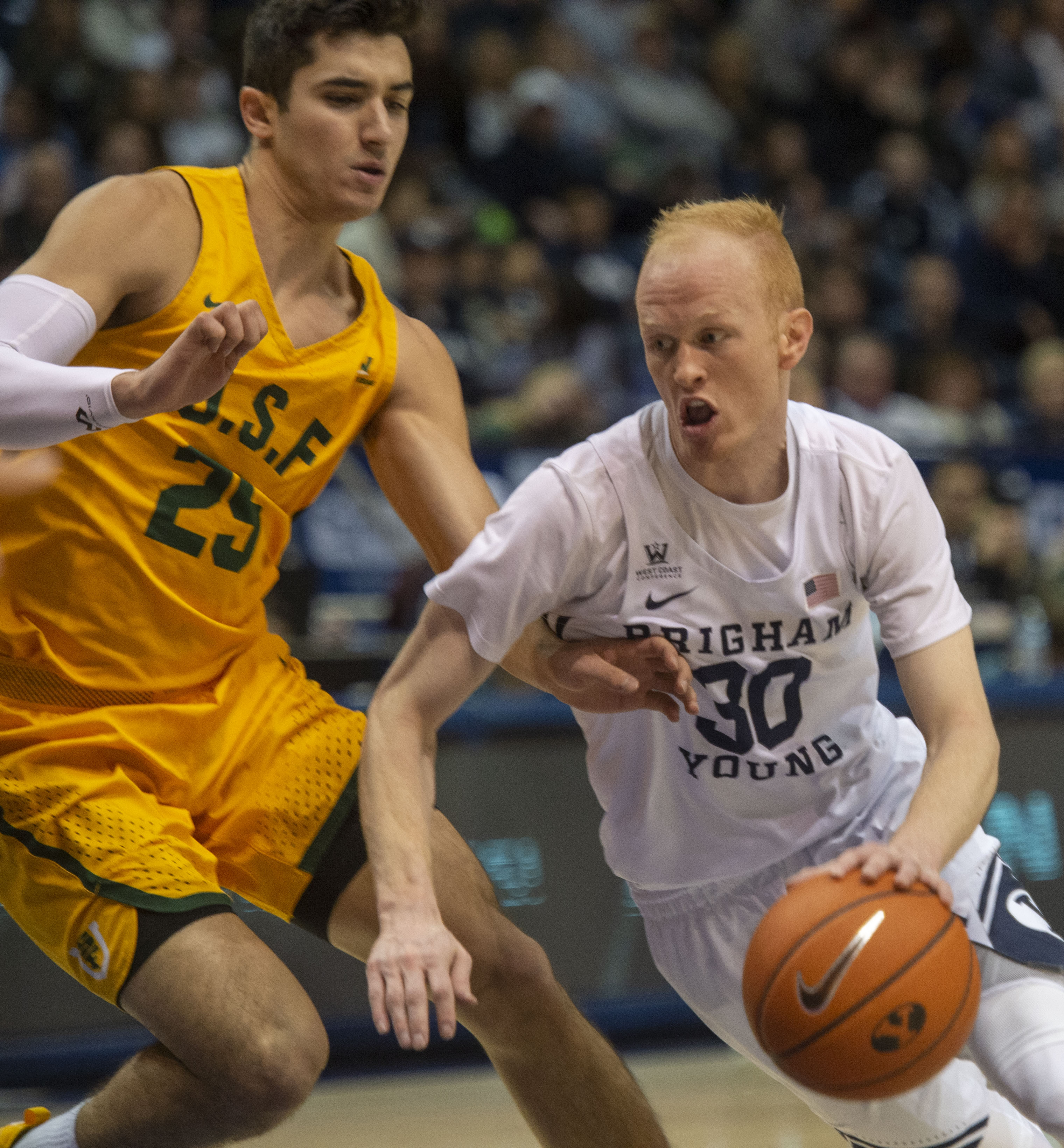 (Rick Egan  |  The Salt Lake Tribune)      Brigham Young Cougars guard TJ Haws (30) takes the ball up the middle, as San Francisco Dons guard Jordan Ratinho (25), in WCC basketball action at the Marriott Center, Thursday, February 21, 2018.