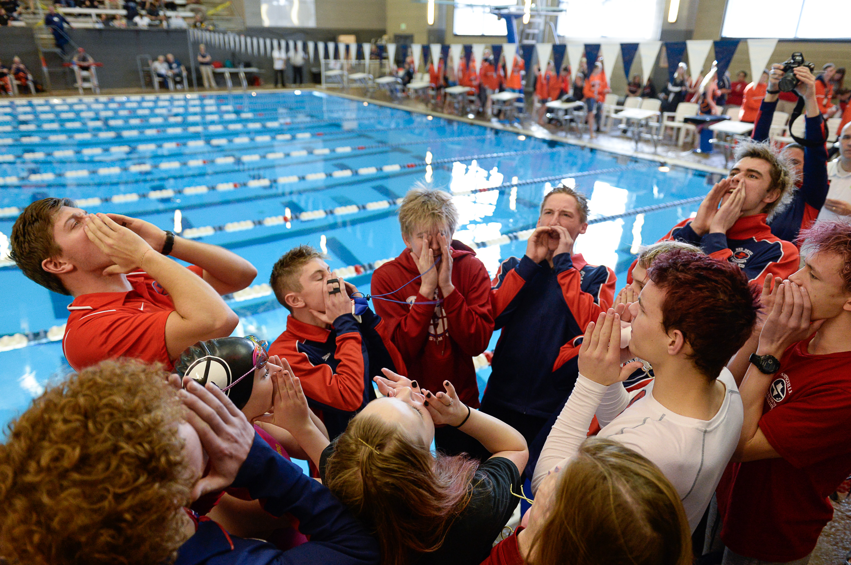 (Francisco Kjolseth  |  The Salt Lake Tribune)  The Springville team gets pumped up before the start of the high school swimming 5A State Championships in Bountiful, Friday February 9, 2018.