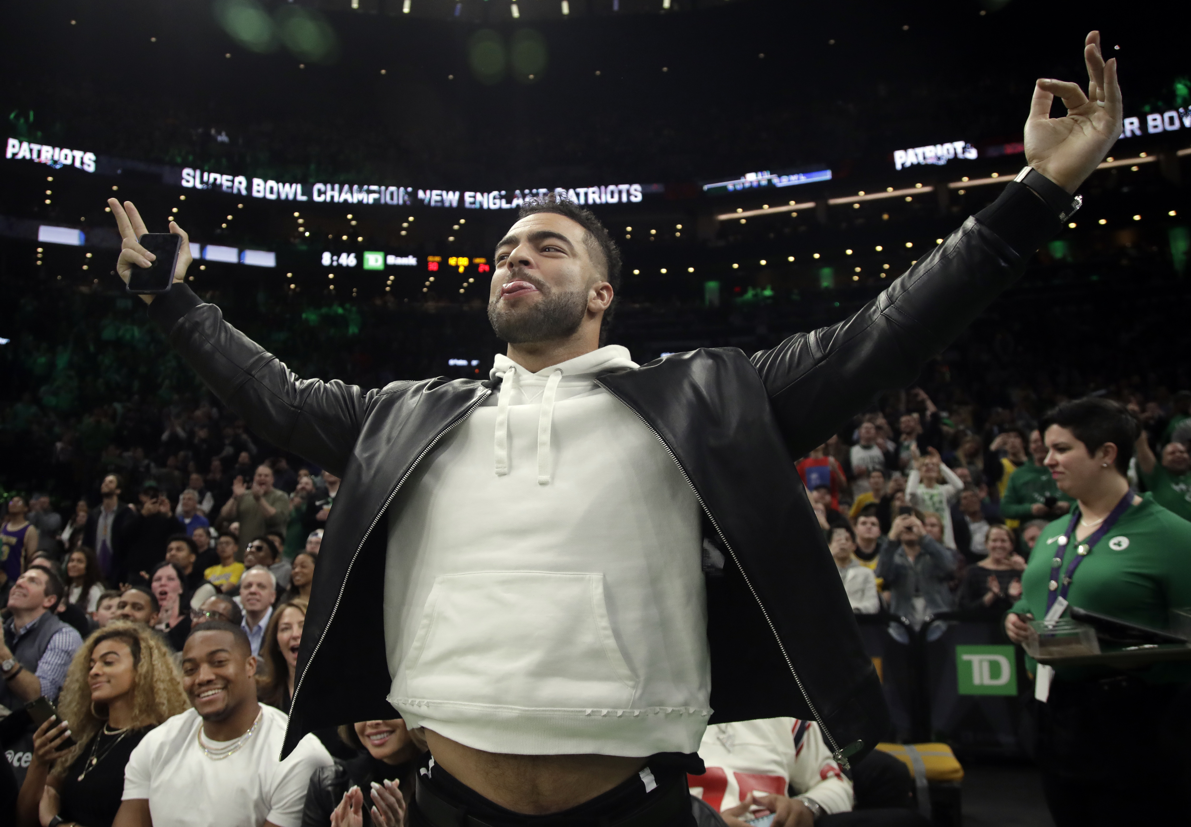 (AP Photo/Elise Amendola) New England Patriots football player Kyle Van Noy acknowledges the fans as the Patriots' Super Bowl victory is honored during a break in an NBA basketball game between the Boston Celtics and the Los Angeles Lakers, Thursday, Feb. 7, 2019, in Boston.