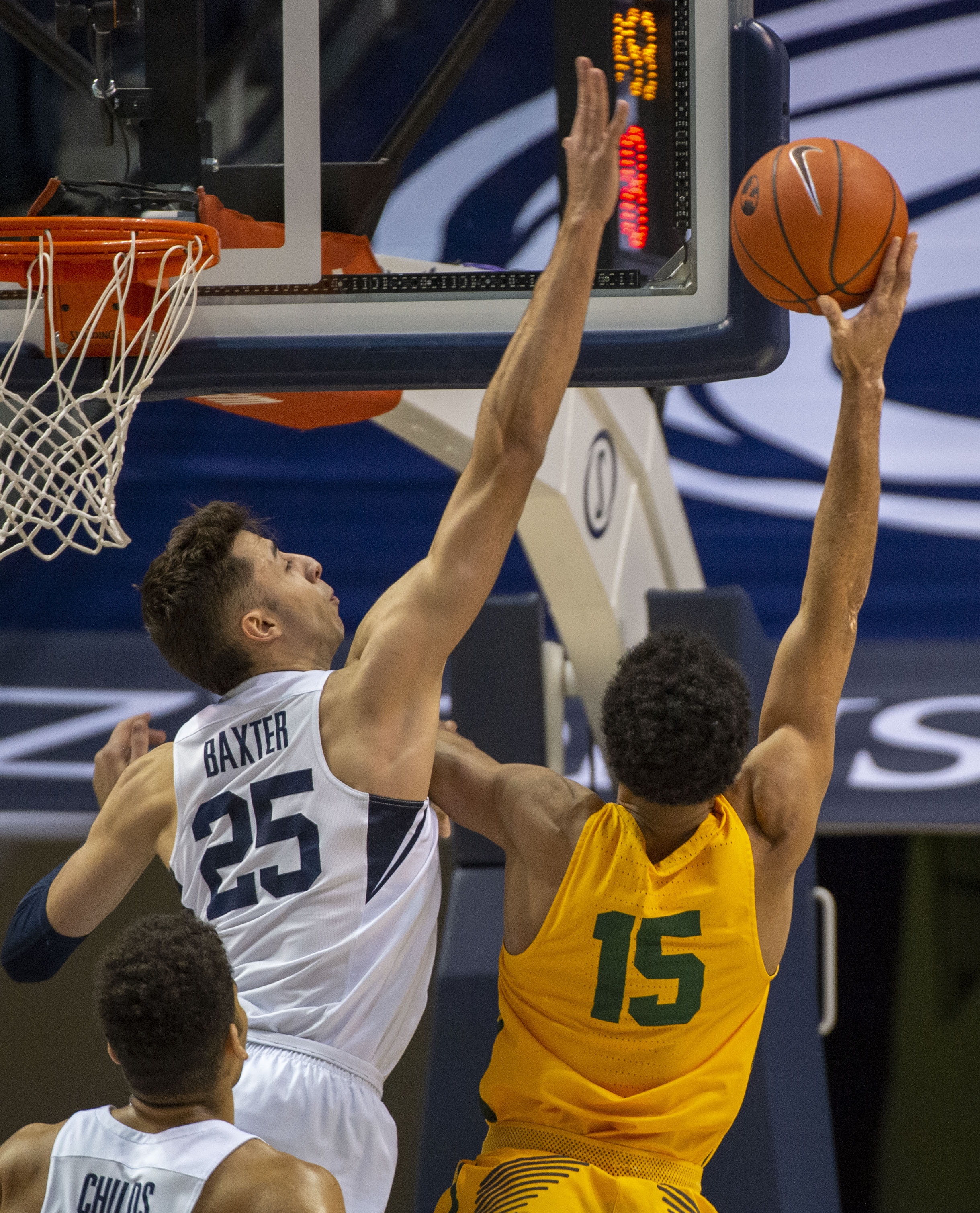 (Rick Egan  |  The Salt Lake Tribune)      San Francisco Dons forward Nate Renfro (15) shoots overBrigham Young Cougars forward Gavin Baxter (25), in WCC basketball action at the Marriott Center, Thursday, February 21, 2018.