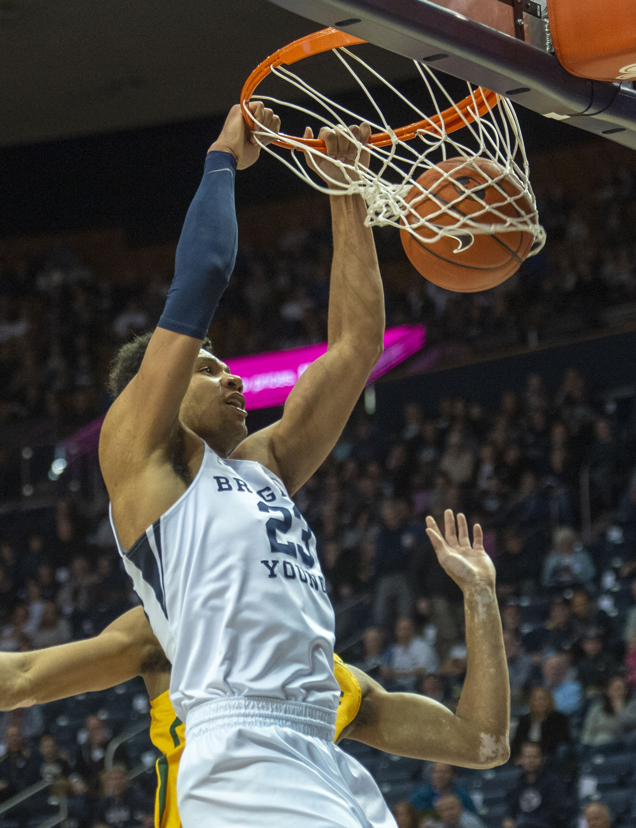 (Rick Egan  |  The Salt Lake Tribune)  Brigham Young forward Yoeli Childs (23) dunks for the Cougars, in WCC basketball action at the Marriott Center, Thursday, February 21, 2018.