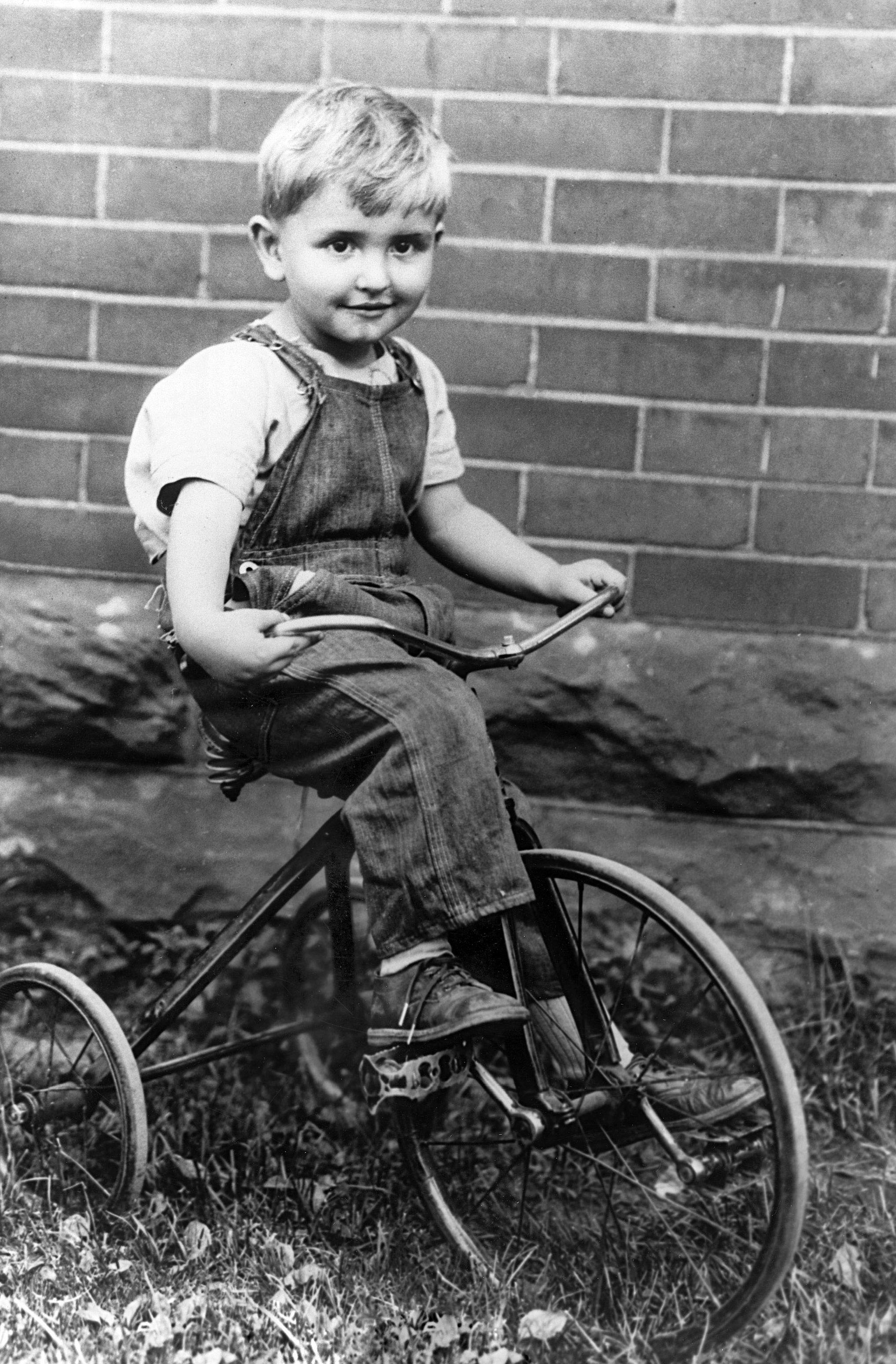 (Photo courtesy LDS Church) Thomas S. Monson on his bike as a young boy.