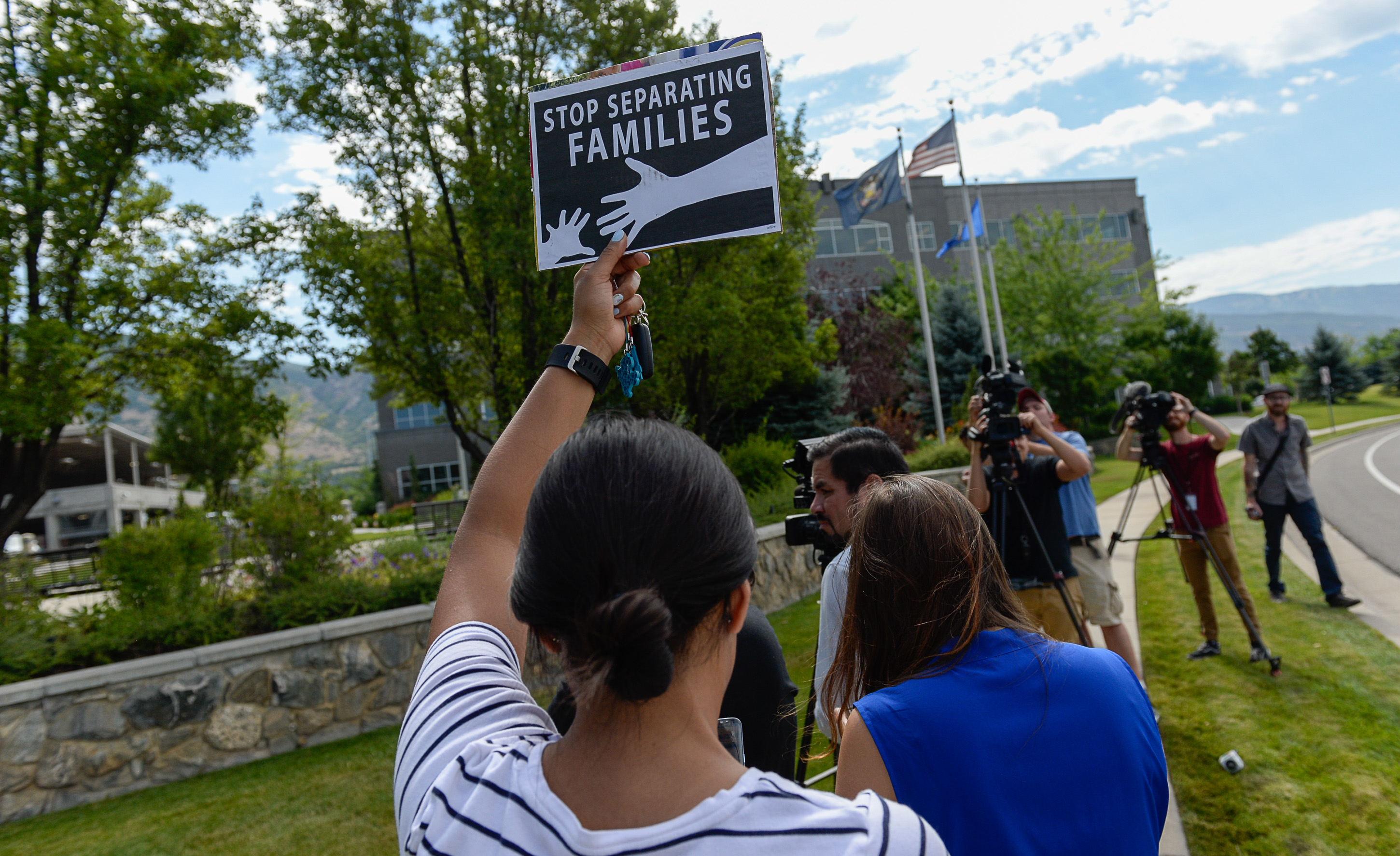 (Francisco Kjolseth  |  The Salt Lake Tribune)  Activists stage a protest against a private prison company with contracts to hold undocumented immigrants on Thursday, July 12, 2018, at the headquarters of Management and Training Corporation in Centerville.