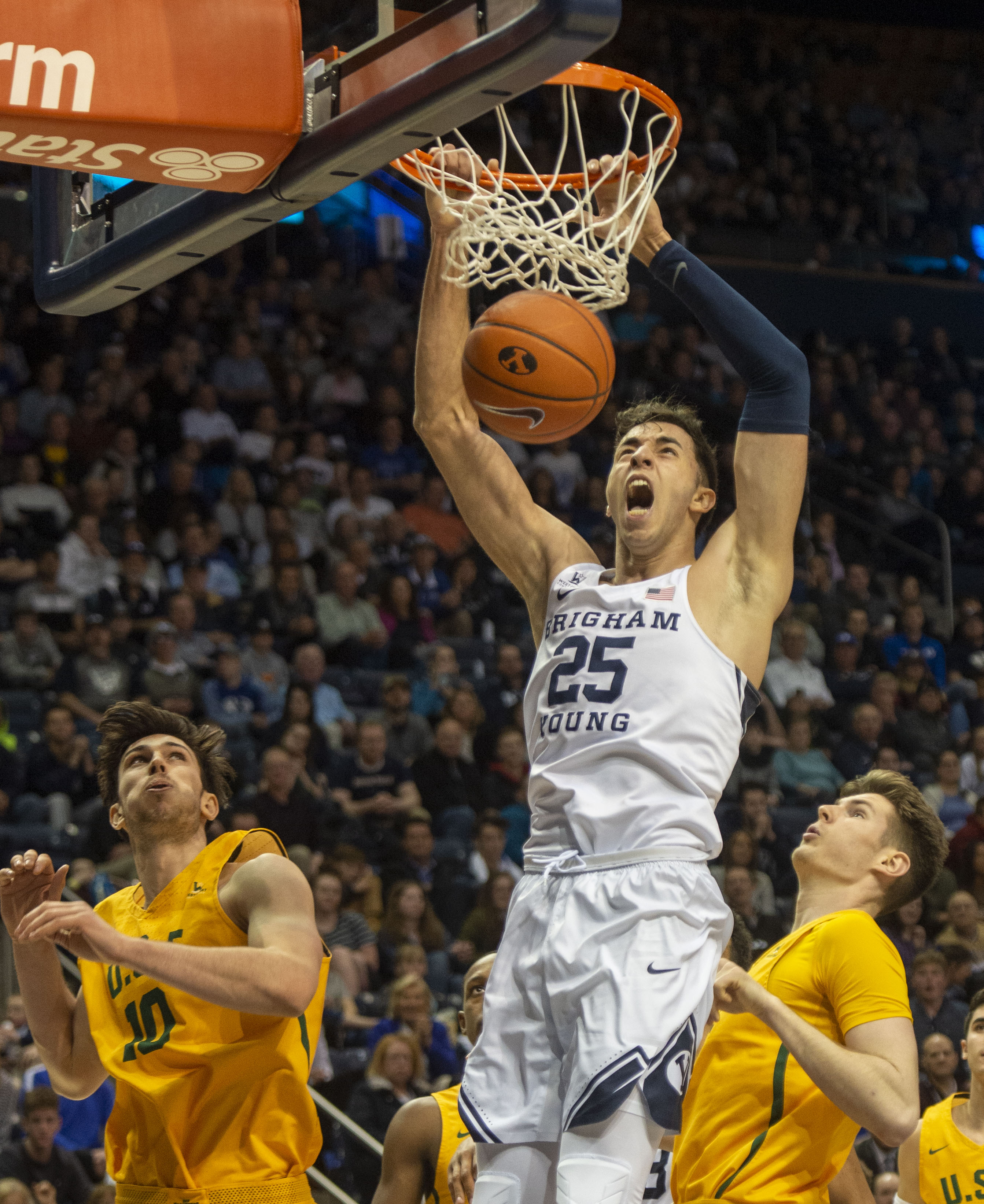 (Rick Egan  |  The Salt Lake Tribune)      Brigham Young forward Gavin Baxter (25) dunks the ball for the Cougars, in WCC basketball action between Brigham Young Cougars and San Francisco Dons, at the Marriott  Center, Thursday, February 21, 2018.