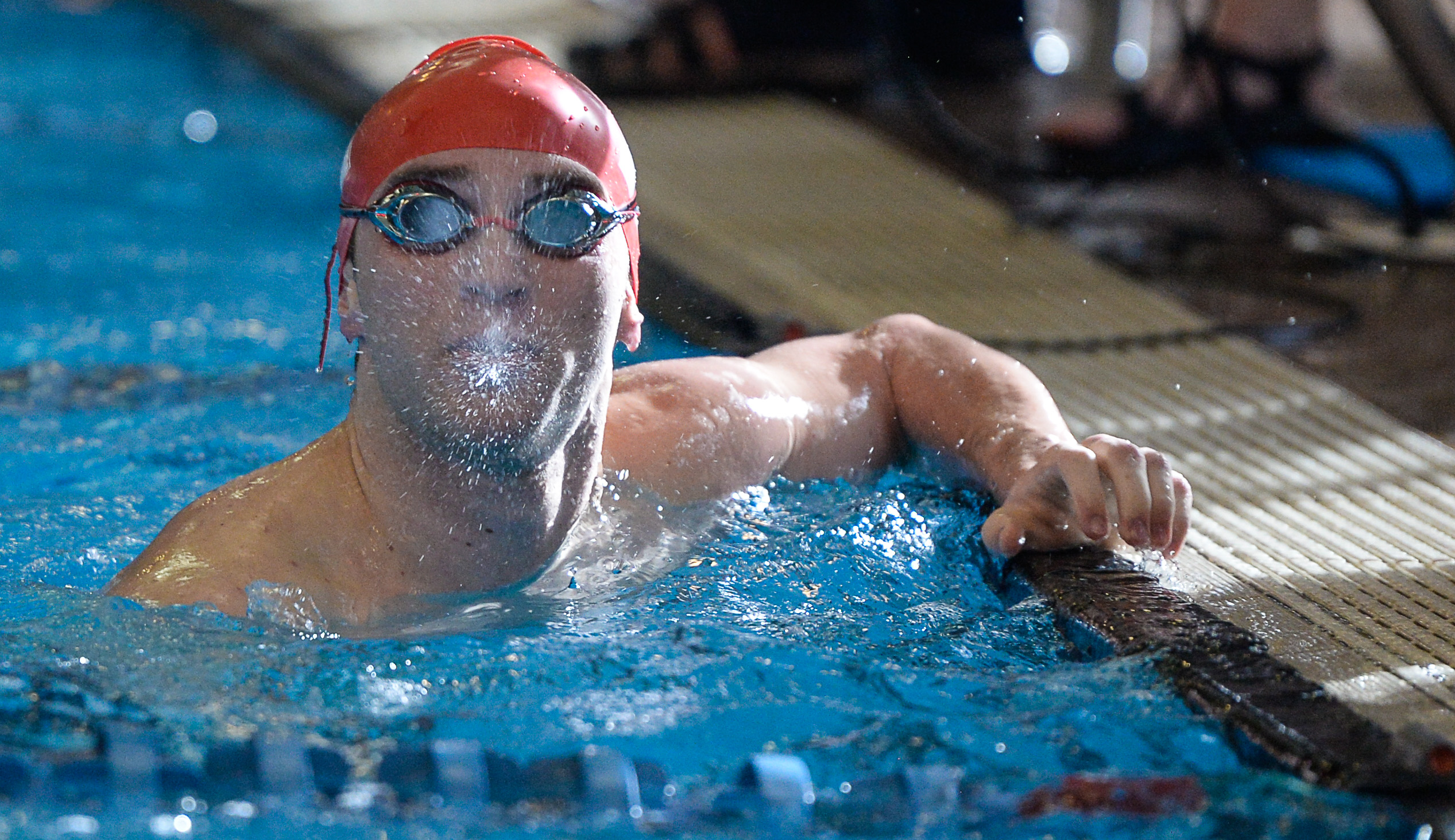 (Francisco Kjolseth  |  The Salt Lake Tribune)  Nathan Van Buren of East looks at his time after competing in the Men 200 Yard IM at the high school swimming 5A State Championships in Bountiful, Friday February 9, 2018.